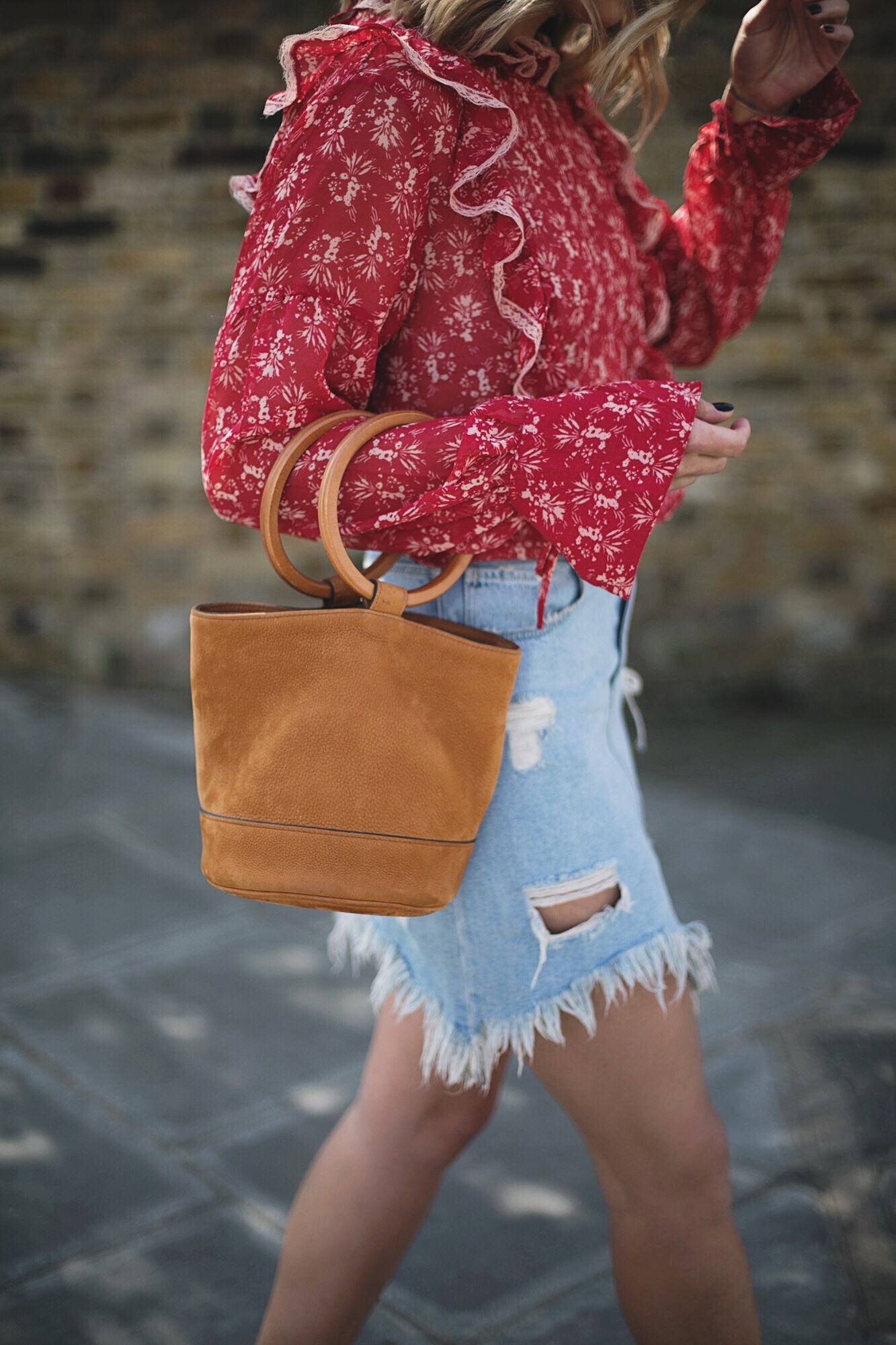 Emma Hill wears red boho blouse, frayed hem denim mini skirt, tan nub Simon Miller Bonsai bag, cute summer outfit
