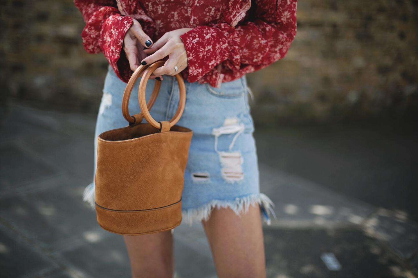 sheer red bohemian top, frayed hem destroyed denim skirt, tan suede Simon miller bonsai bag, summer outfit