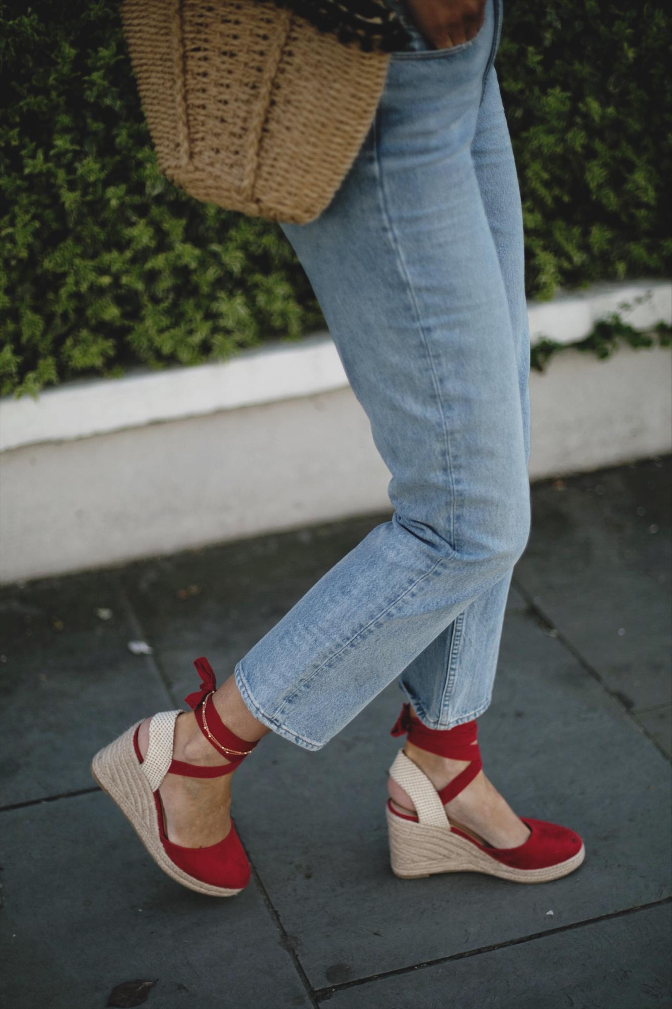 light wash straight leg jeans, straw basket bag, red wedge espadrilles