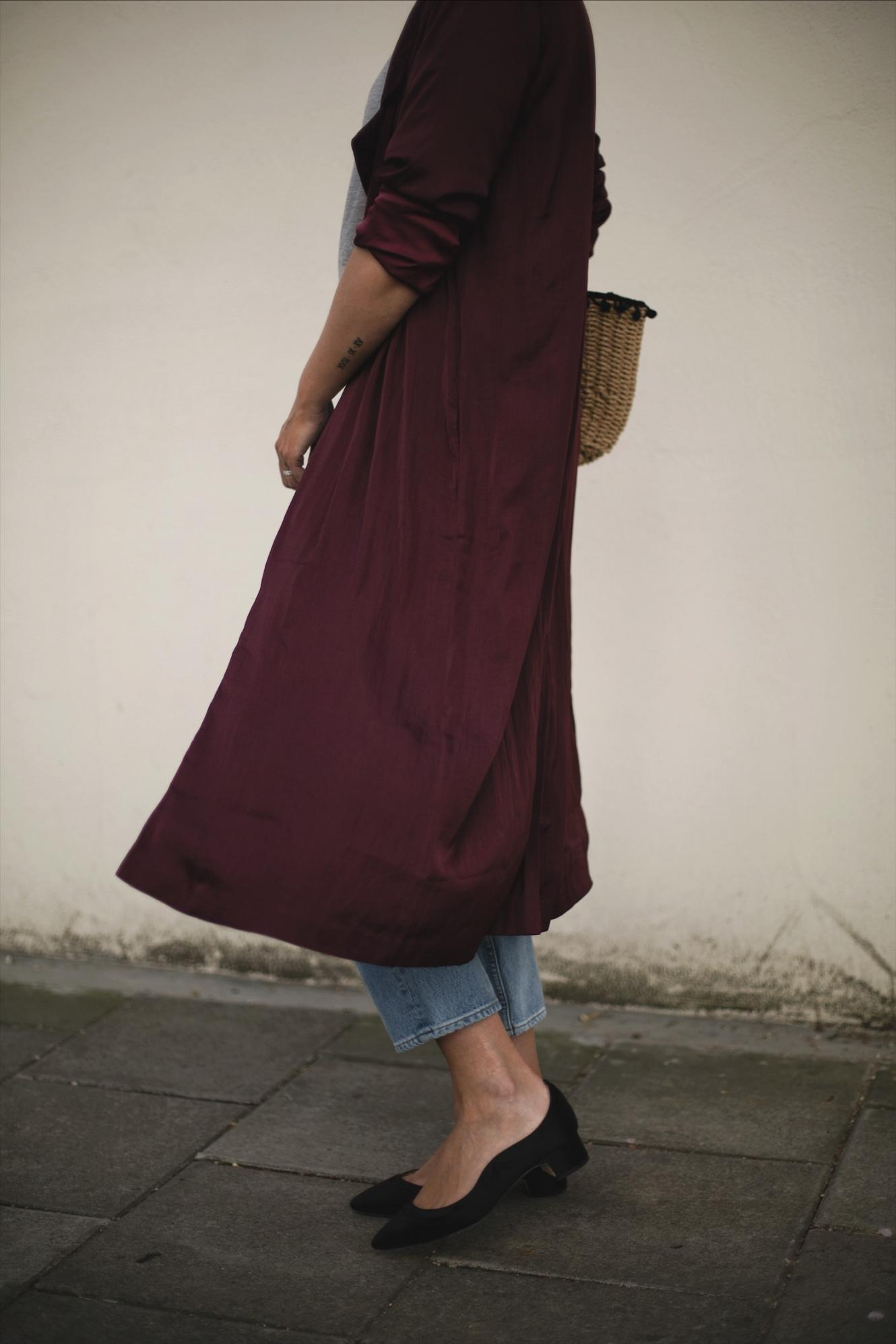 long deep purple wine silky duster jacket, cropped light wash jeans, Dune x Ruperst Sanderson satin low block heels