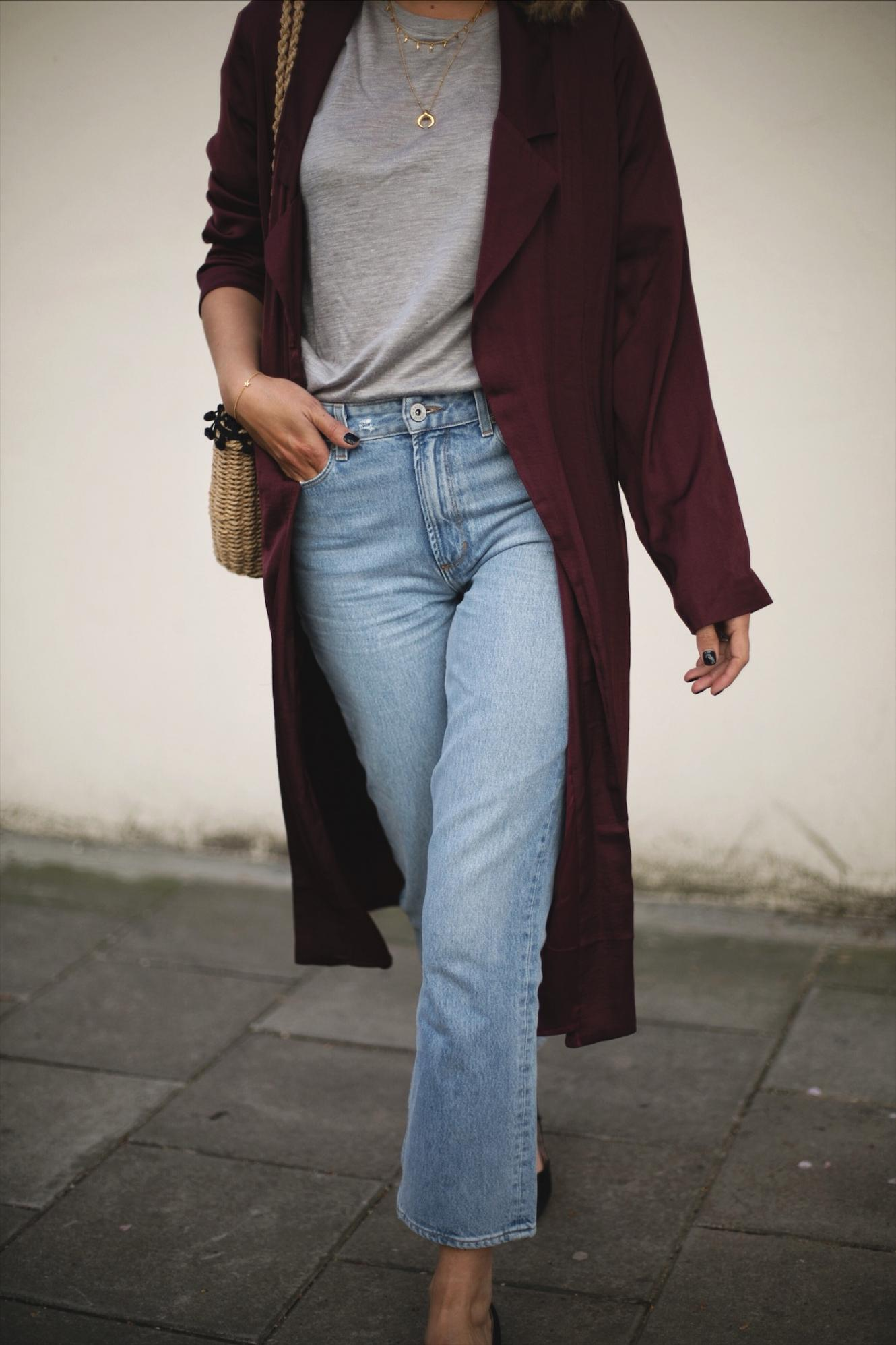 Emma Hill wears deep purple wine silky duster jacket kimono, straw basket bag with pom pom detail, cropped frayed hem jeans, Dune x Rupert Sanderson low block heels, outfit ideas for Spring