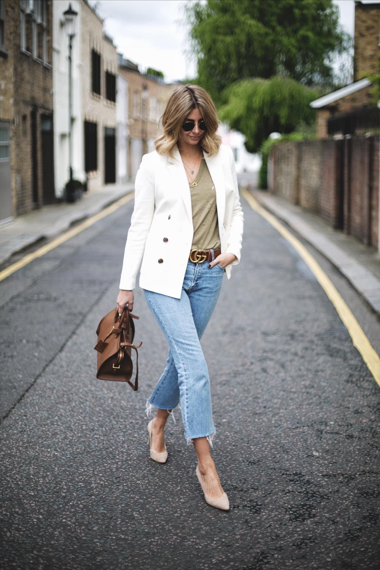 Emma Hill wears off white double breasted blazer, khaki nibbled t-shirt, frayed hem cropped jeans, beige suede Jimmy Choo Romy pumps, YSL Saint Laurent Cabas Chyc in tan leather, Ray Ban round sunglasses, chic spring outfit