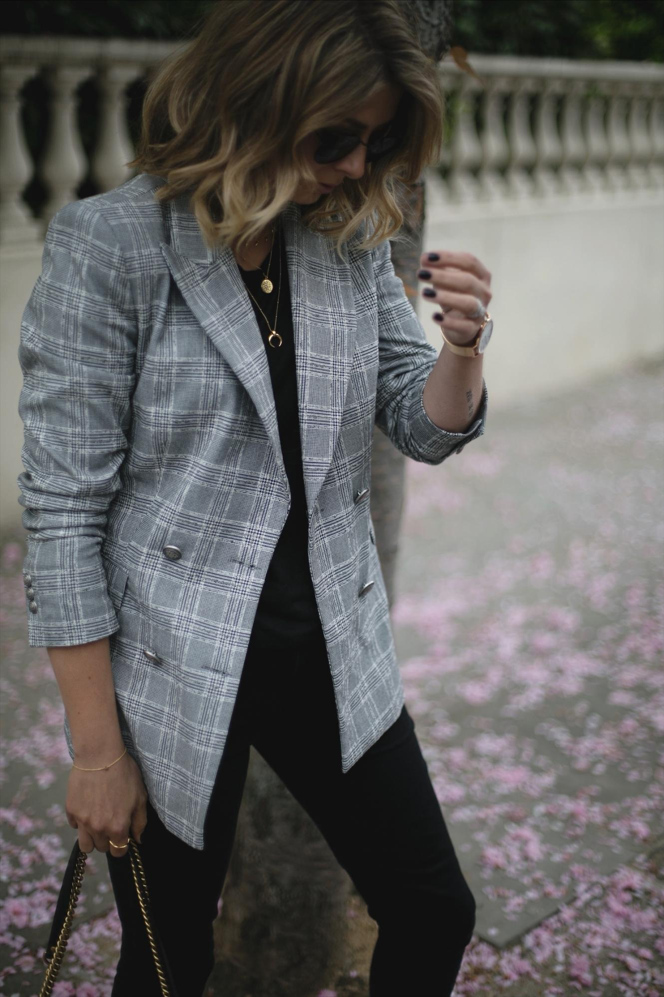 Emma Hill wears check Zara blazer, gold layered necklaces, black t-shirt, black skinny jeans,