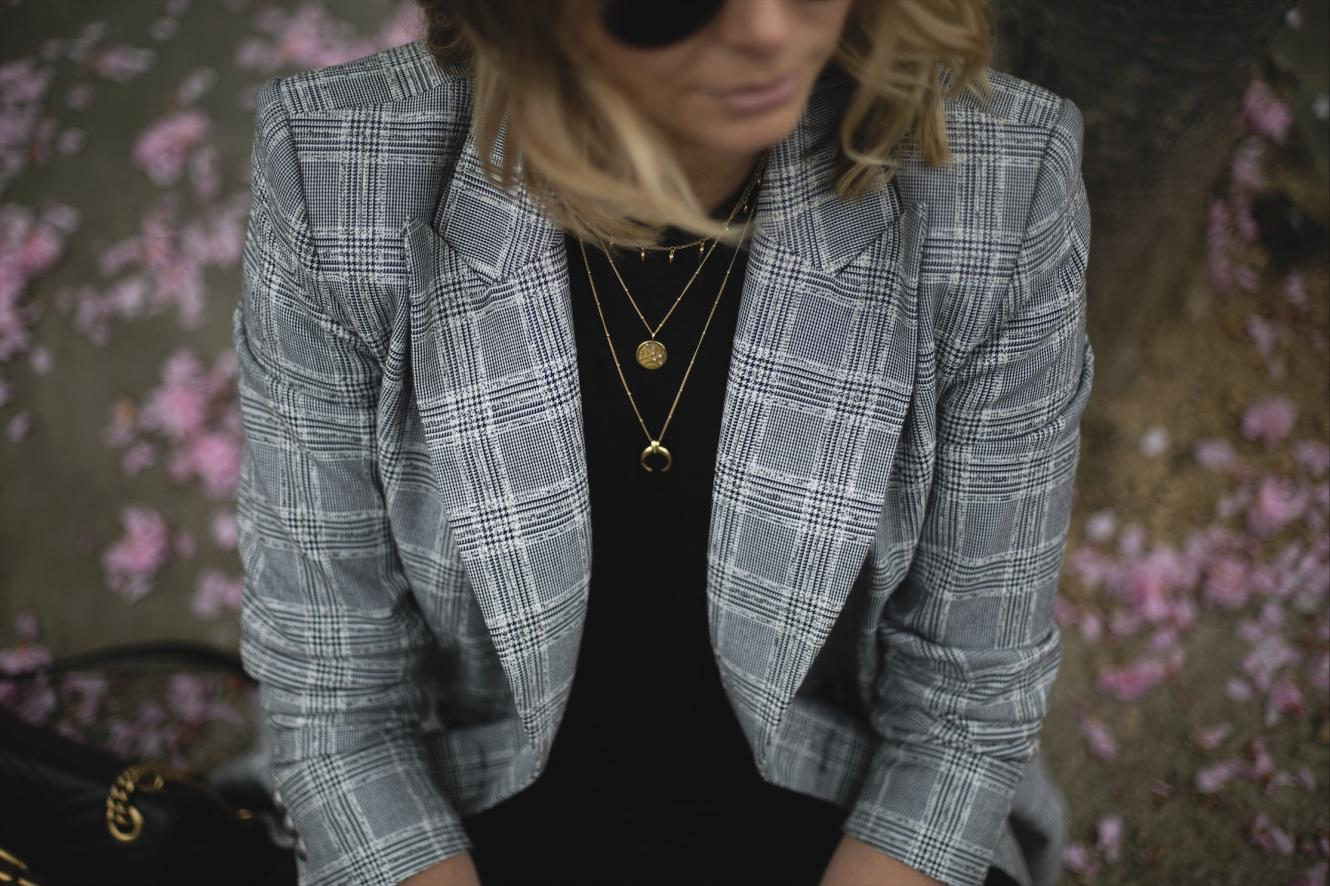 Check blazer, black t-shirt, layered gold necklaces