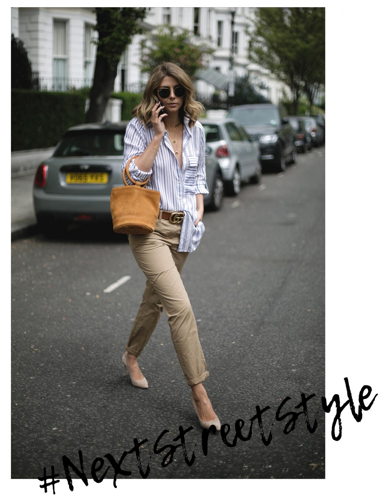 Emma Hill wears stripe shirt, tan suede Simon Miller bag, chinos, suede pumps, street style photography