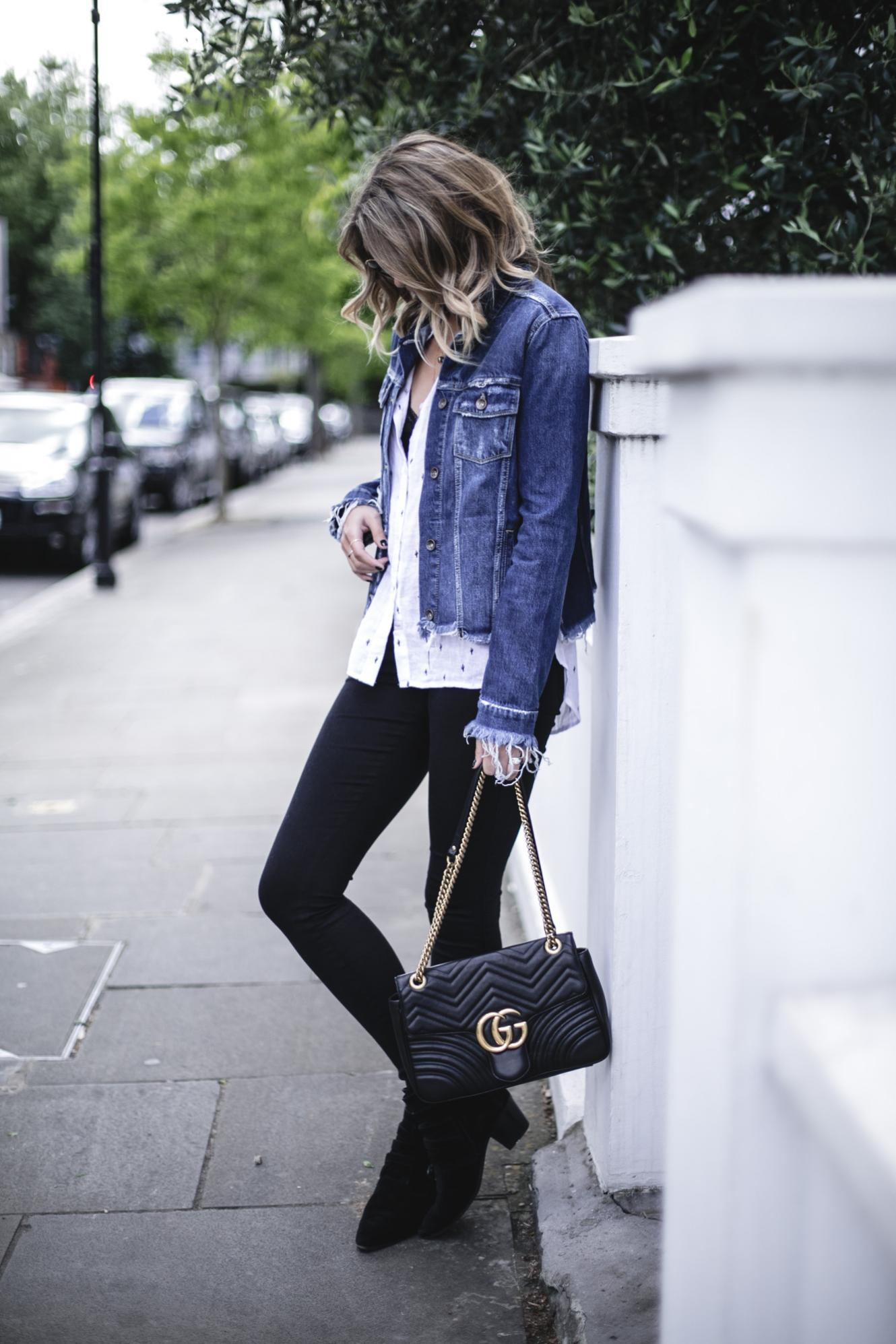 Emma Hill wears Paige frayed denim jacket, Rails white linen cactus print shirt, black skinny jeans, Gucci marmont bag, black buckle ankle boots, casual Spring outfit
