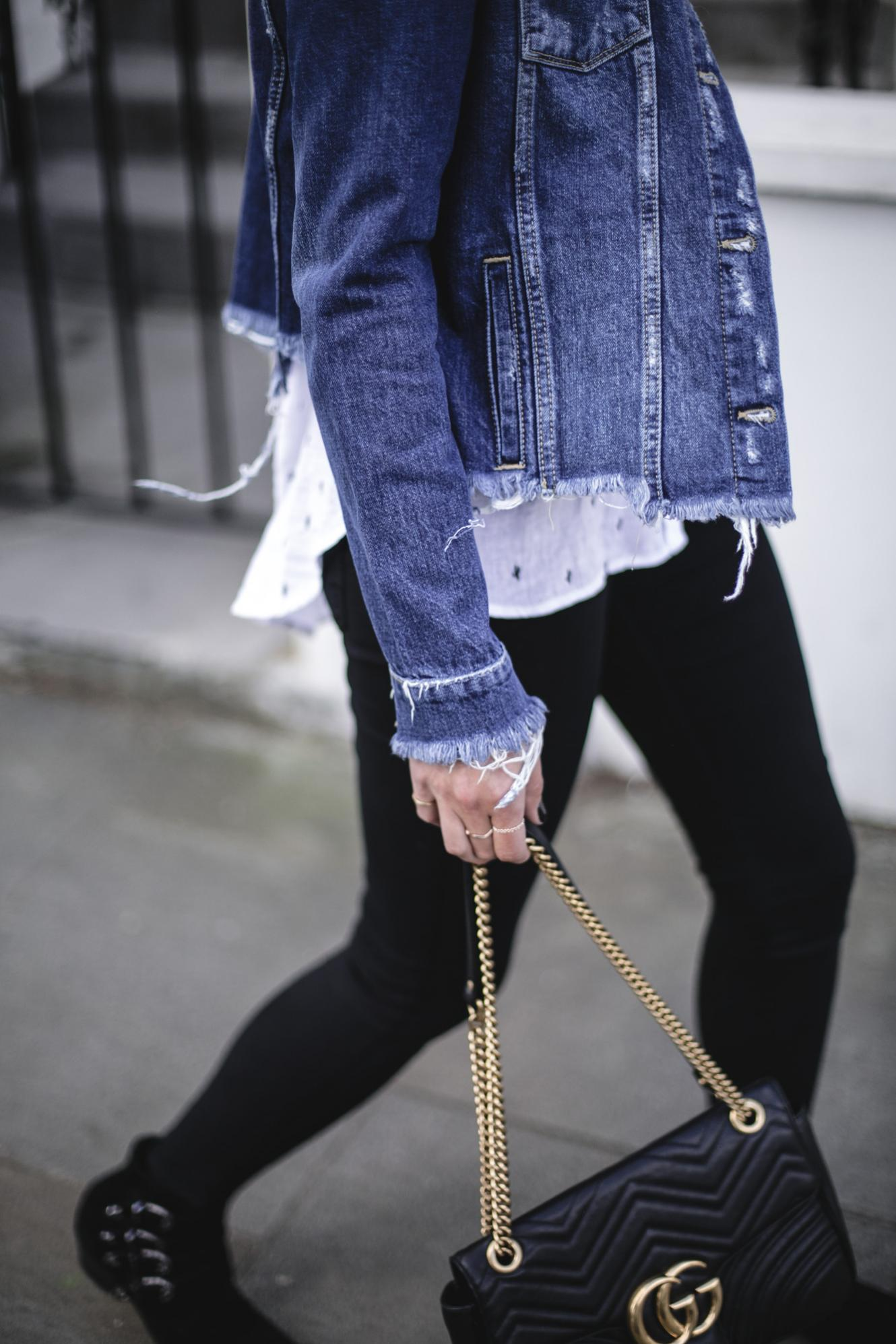 Emma Hill wears Paige frayed denim jacket, Rails white linen cactus print shirt, black skinny jeans, Gucci marmont bag, black suede buckle ankle boots