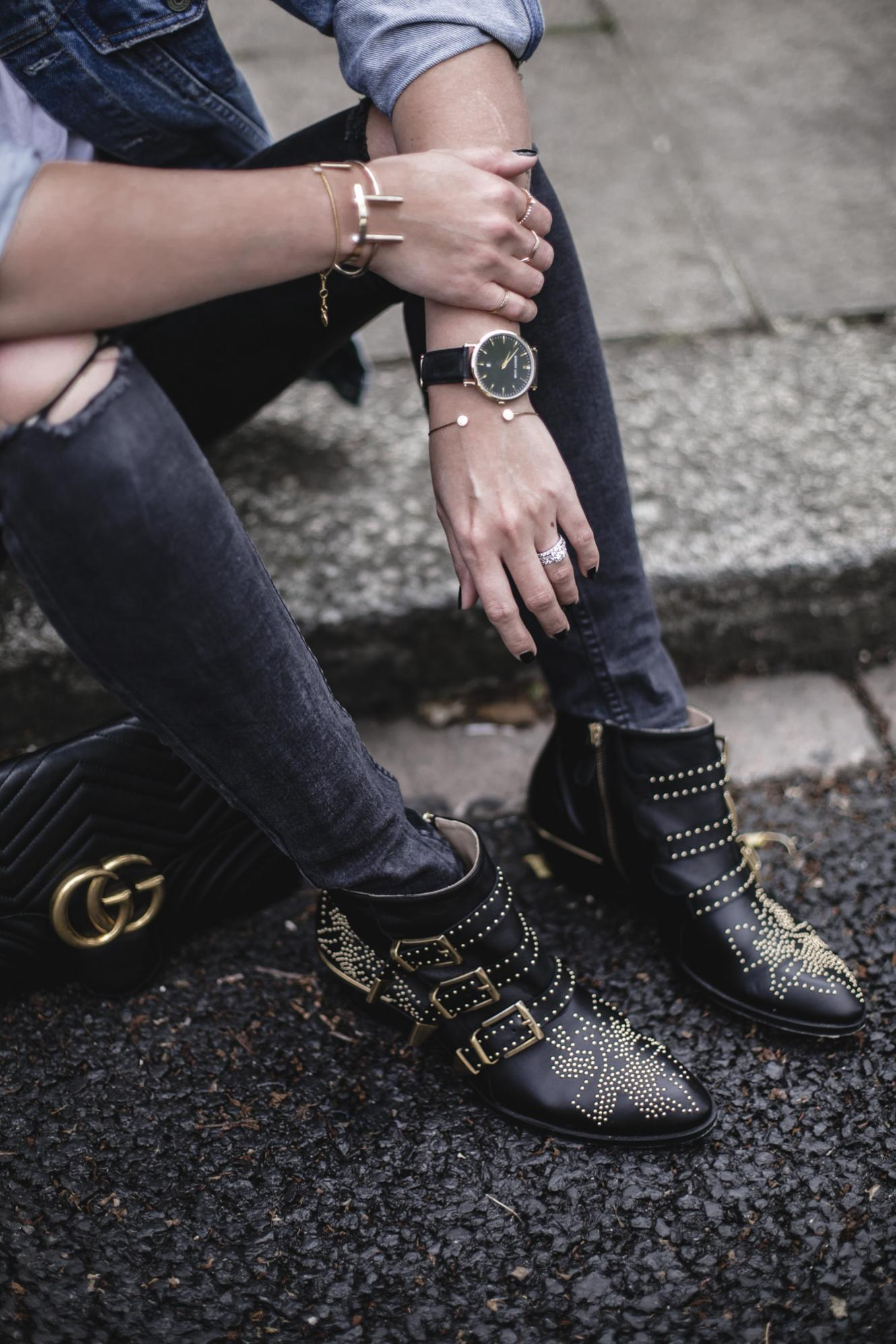 Emma Hill wears black ripped skinny jeans, Chloe Susanna ankle boots, Gucci marmot bag