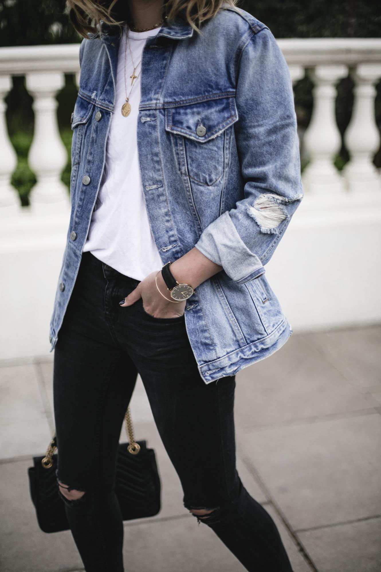Emma Hill wears Grlfrnd oversized denim jacket, white t-shirt, black skinny jeans, gold jewellery, Gucci Marmont bag