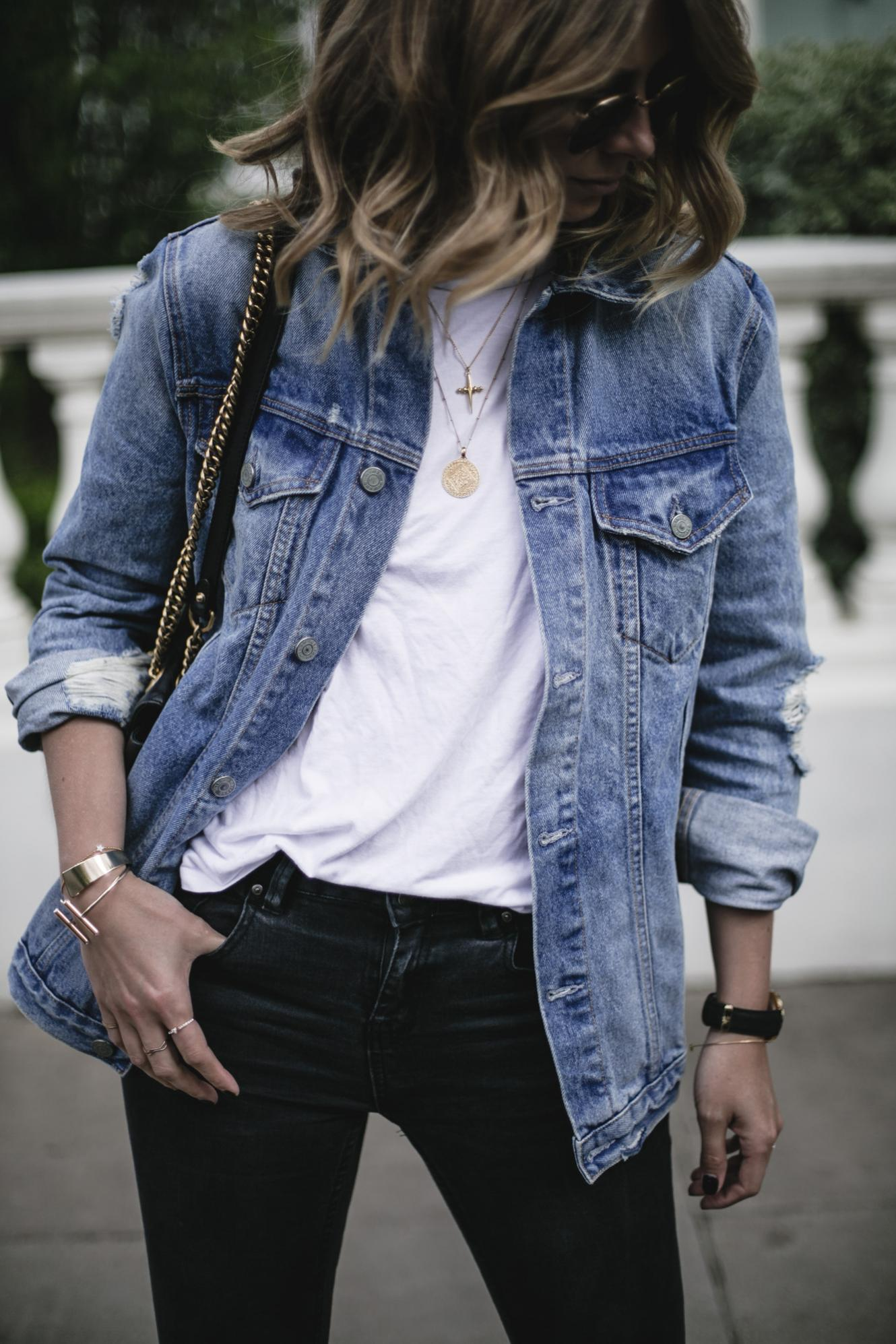 Emma Hill wears Grlfrnd oversized denim jacket, white t-shirt, black skinny jeans, gold jewellery