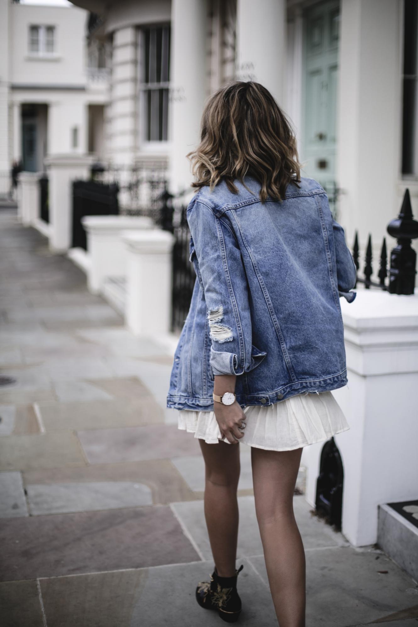 Emma Hill wears oversized denim jacket, boho mini dress, Gucci Marmont bag, Chloe Susanna boots, summer outfit