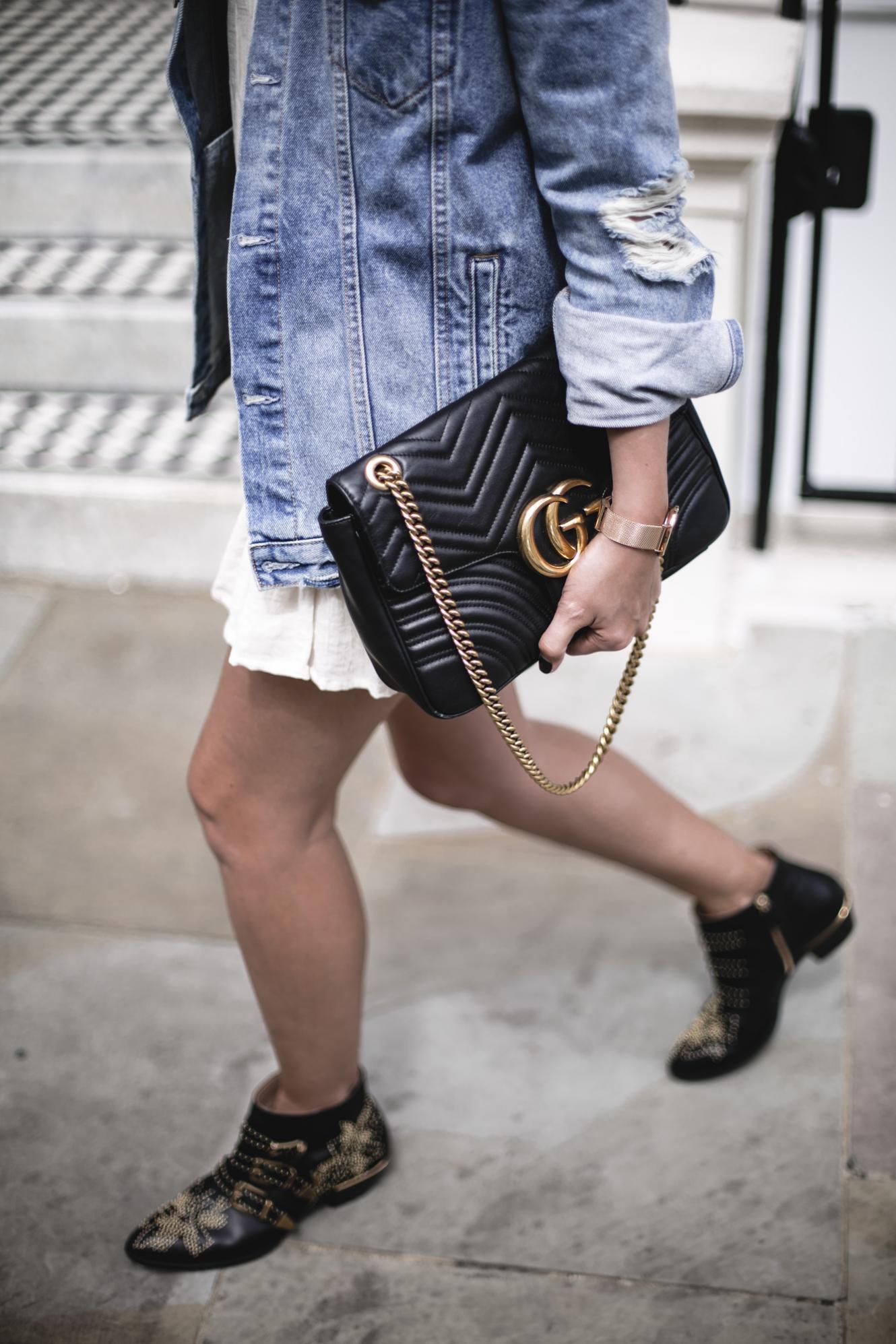 Emma Hill wears oversized denim jacket, boho mini dress, Chloe Susanna boots, Gucci Marmont bag, summer outfit