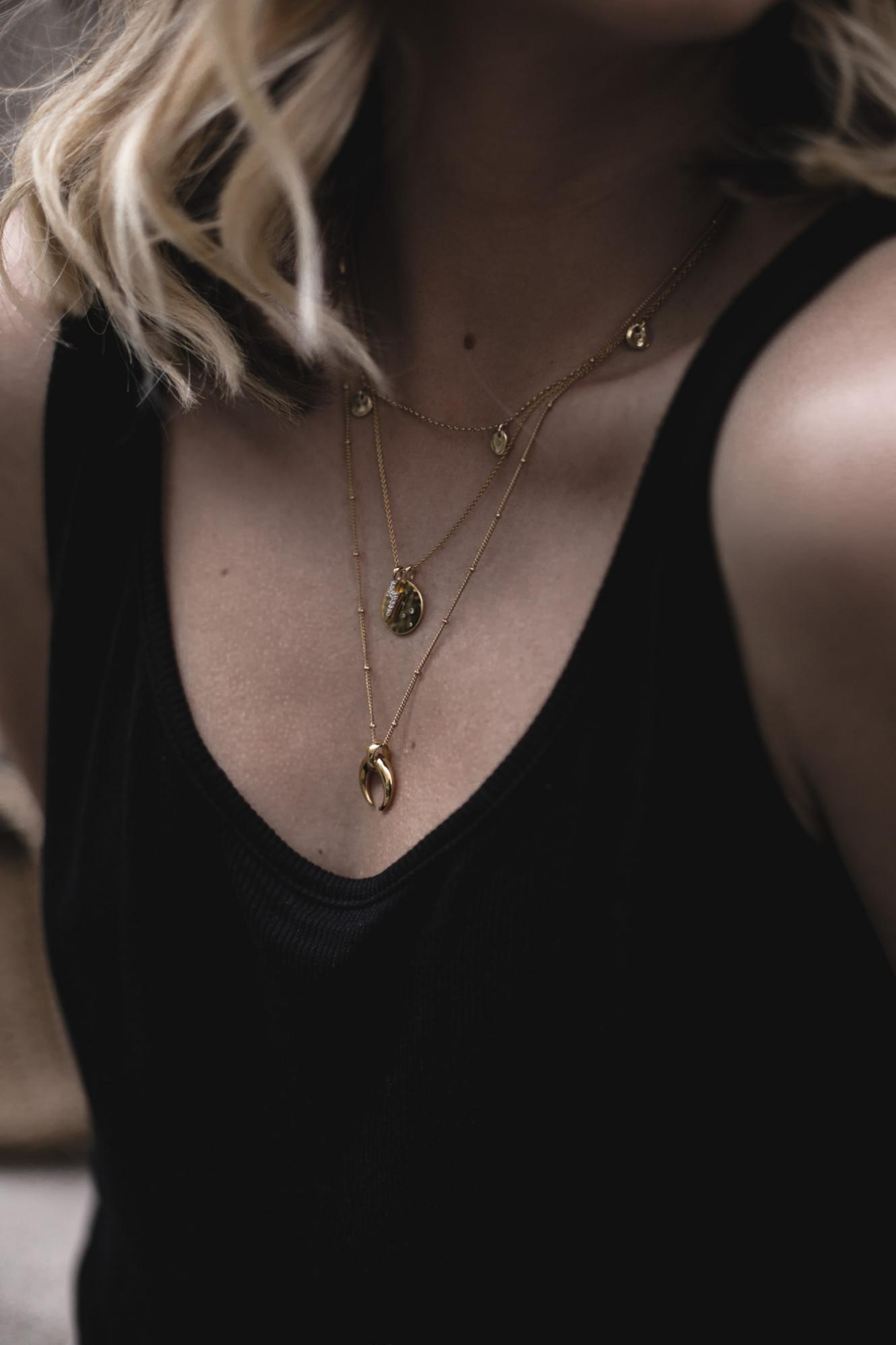 EJSTYLE | black vest top, gold layered necklaces