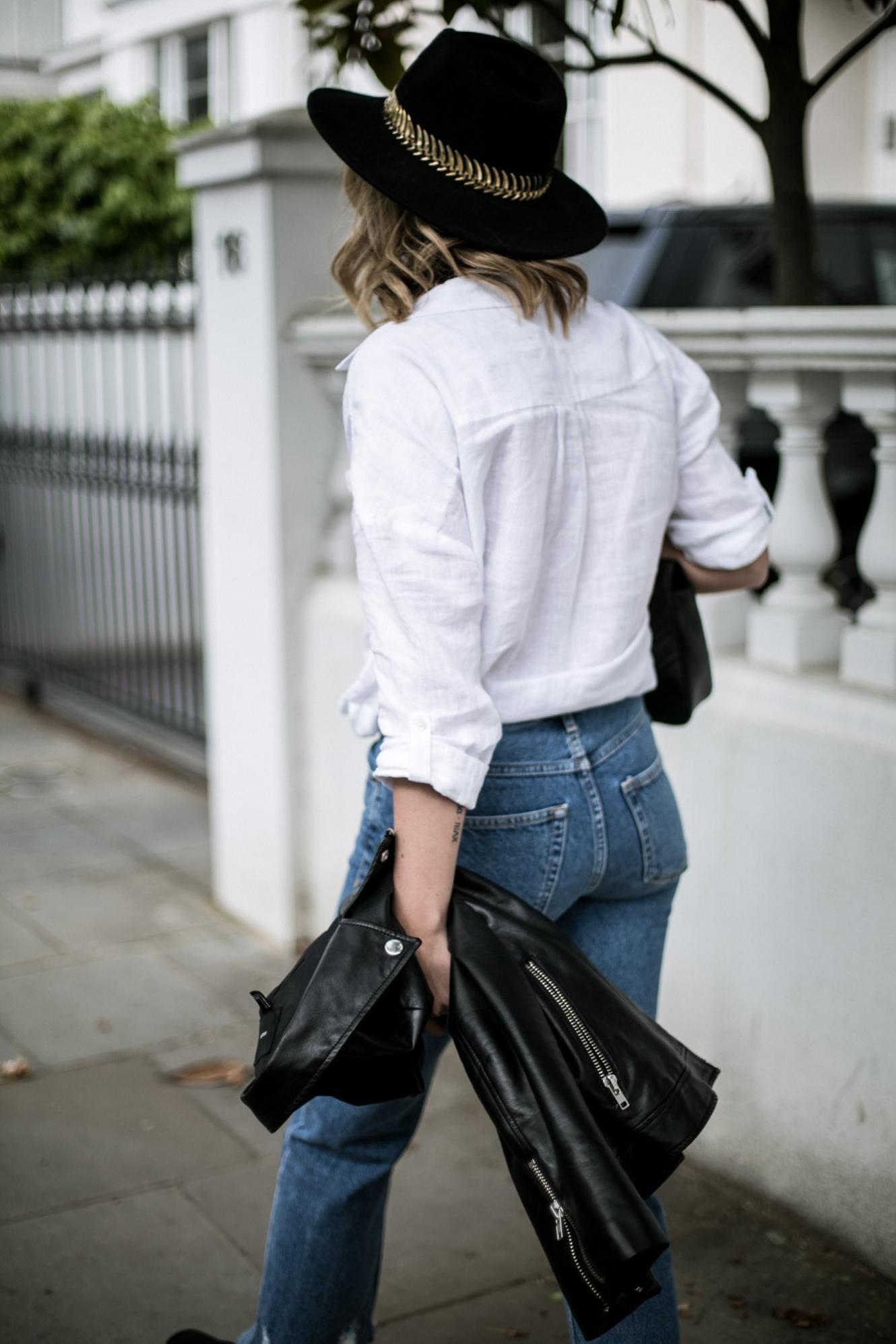 white linen shirt, black leather biker jacket, gold band black fedora, jeans