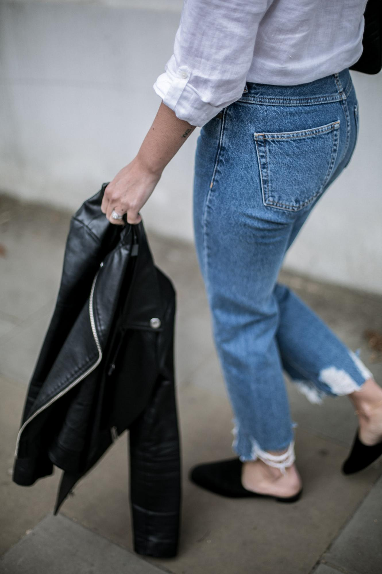 frayed hem jeans, satin mules, white shirt, biker jacket