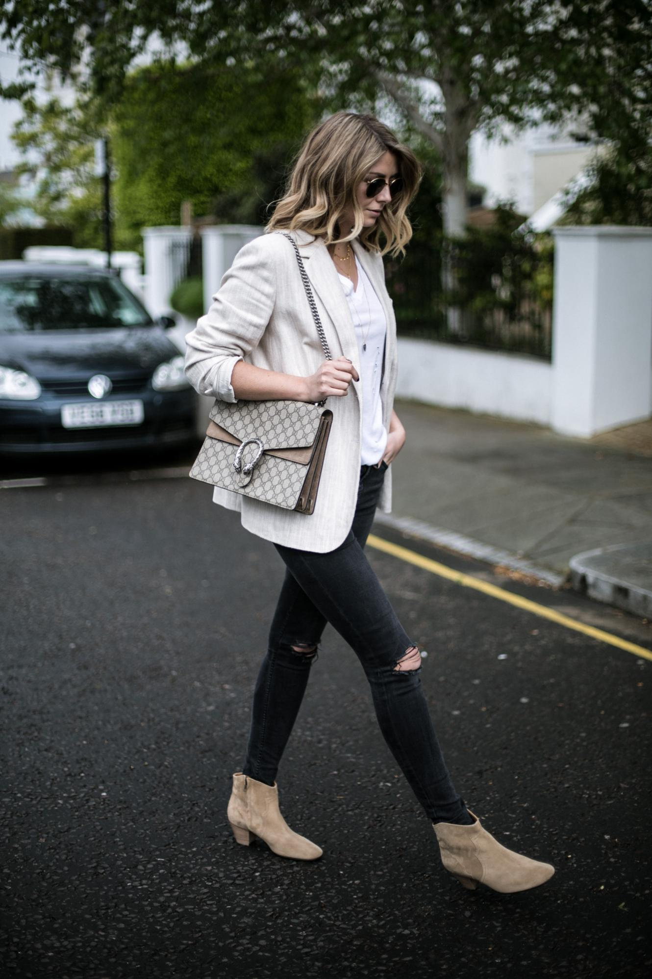 Emma Hill of EJSTYLE wears beige linen blazer, white t-shirt, Gucci Dionysus bag, black skinny jeans ripped knees, beige suede Isabel marant dicker boots, chic Spring outfit