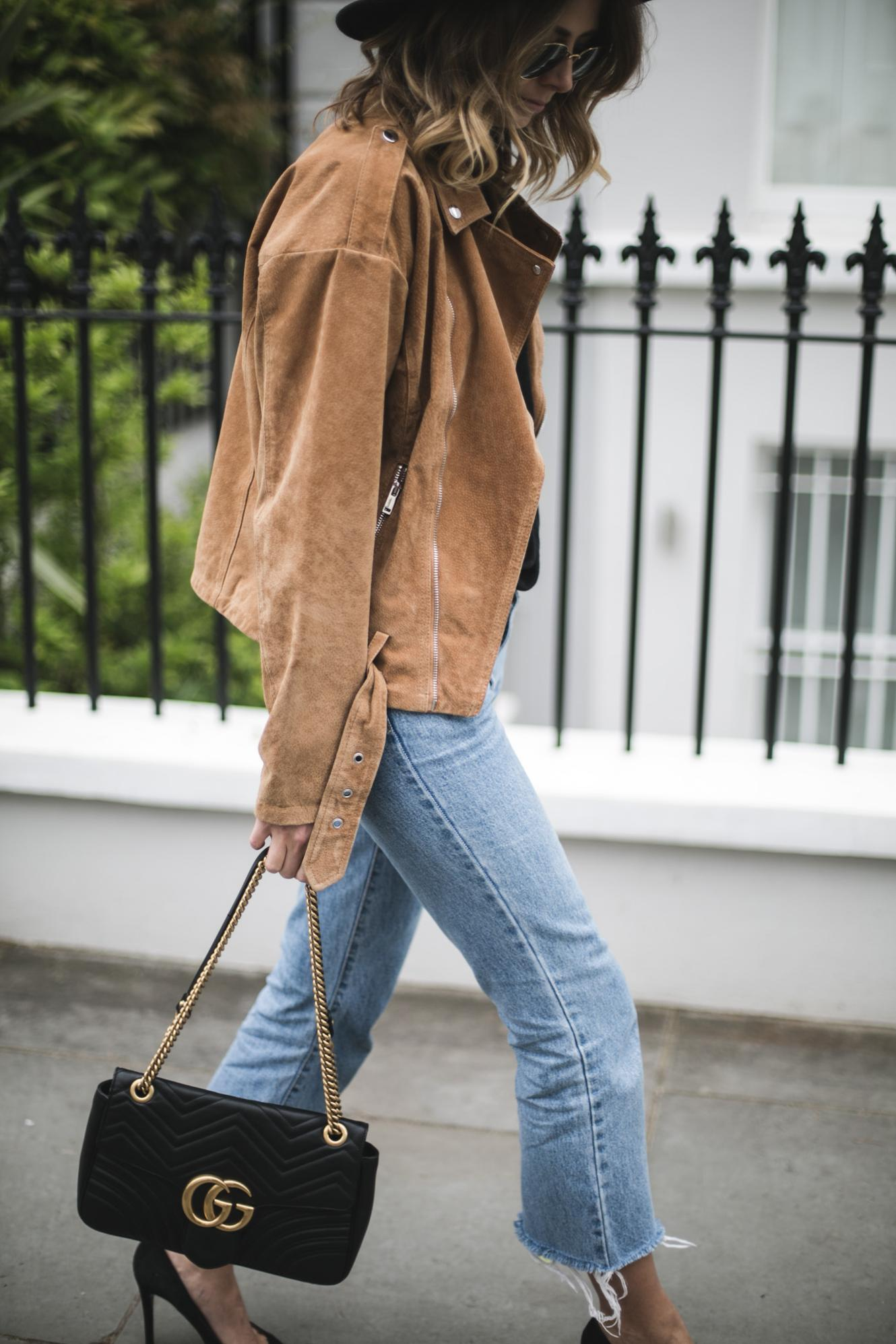 Emma Hill of EJSTYLE wears tan suede jacket, cropped flare jeans with raw hem, black leather Gucci Dionysus bag, chic casual outfit