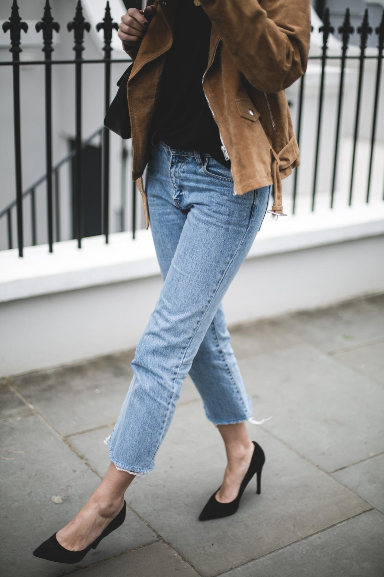 tan suede jacket, black t-shirt, raw frayed hem cropped jeans, suede court shoes