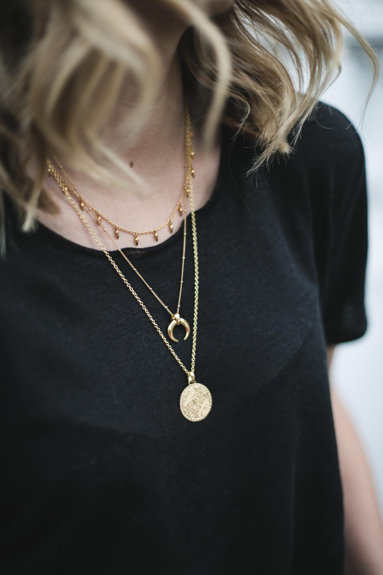 Black t-shirt, lob hair layered gold necklaces