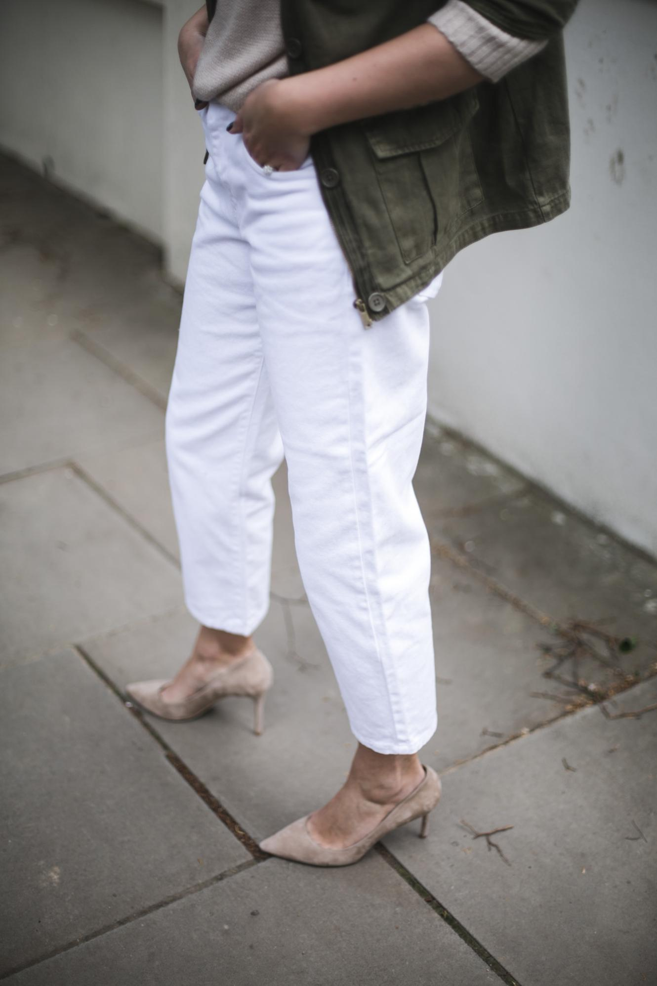 white loose fit jeans, khaki jacket, beige suede Jimmy Choo Romy pumps