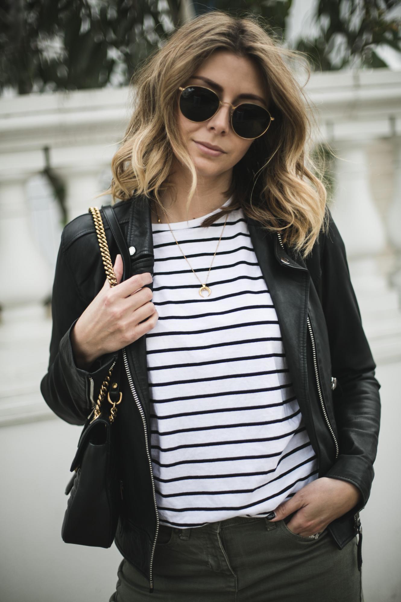Emma Hill of EJSTYLE wears black leather biker jacket, stripe t-shirt, wide leg khaki trousers, Gucci Marmont bag