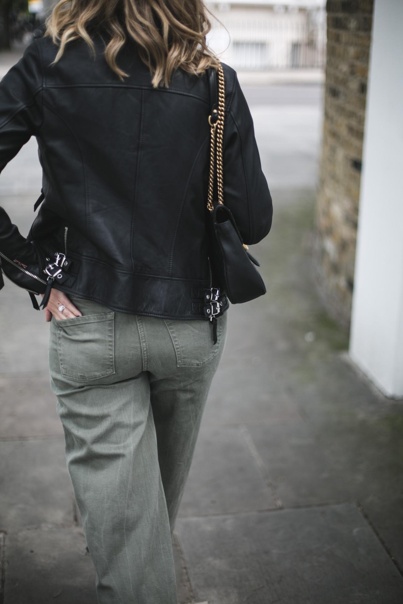 biker jacket, Gucci marmot, khaki wide leg jeans