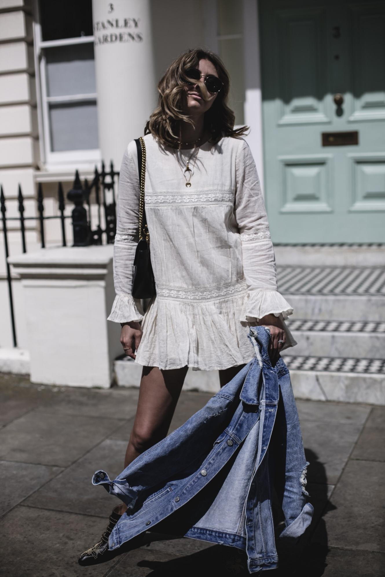 Emma Hill wearing Tularosa boho mini dress, denim jacket, gold layered necklaces, Chloe Susanna boots, Gucci Marmont bag, Summer outfit, festival style