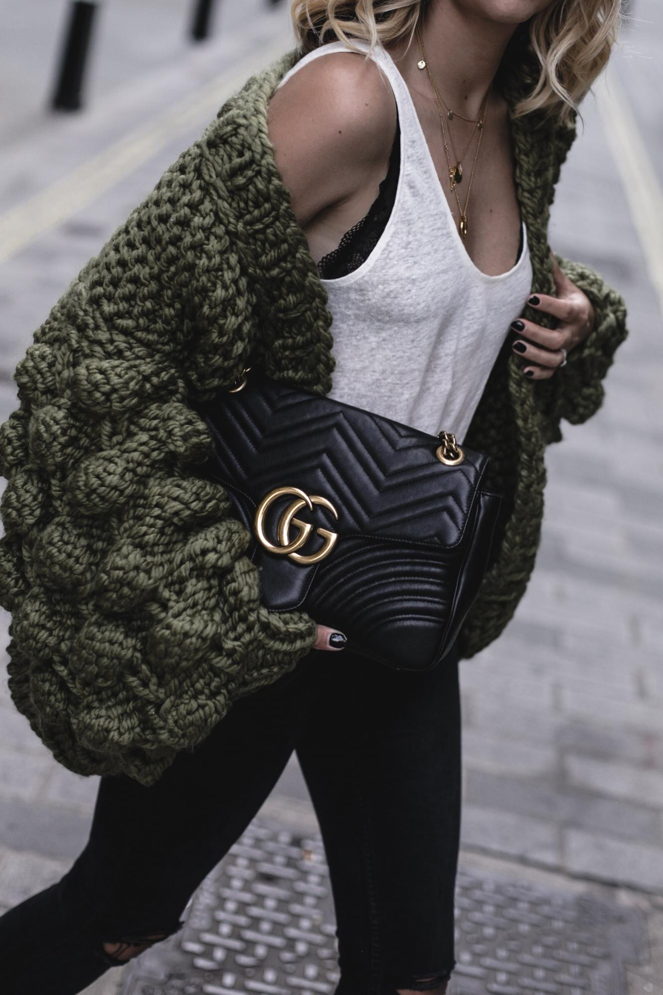 EJ Style | Mumshandmade chunky olive green cardigan, white linen vest top with black lace bra underneath, Gucci Marmont bag, black skinny jeans, street style