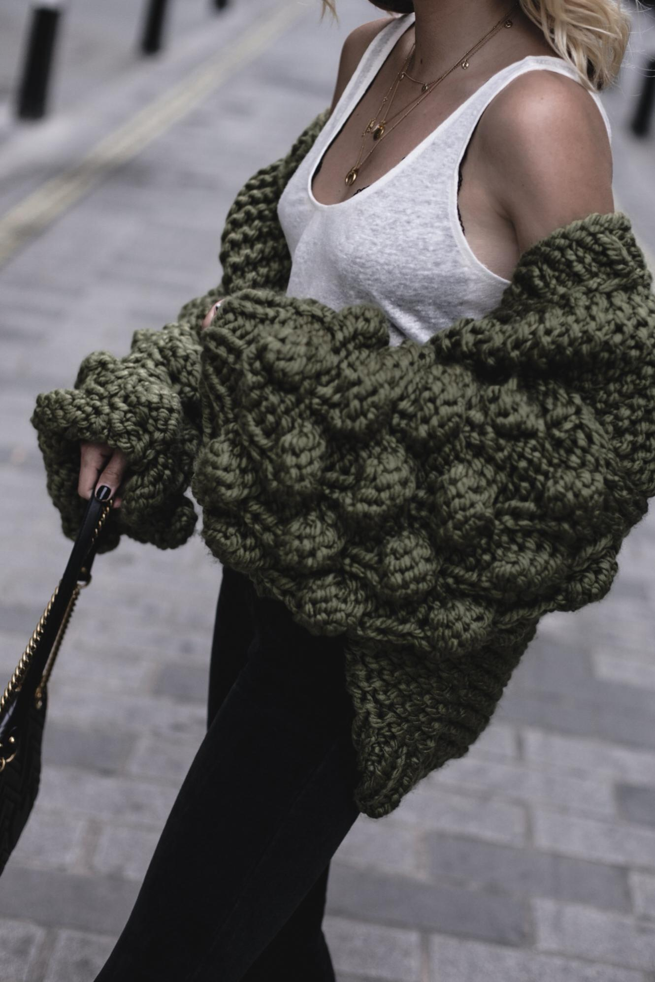 EJ Style | Mumshandmade chunky olive green cardigan, white linen vest top with black lace bra underneath, Gucci Marmont bag, black skinny jeans,