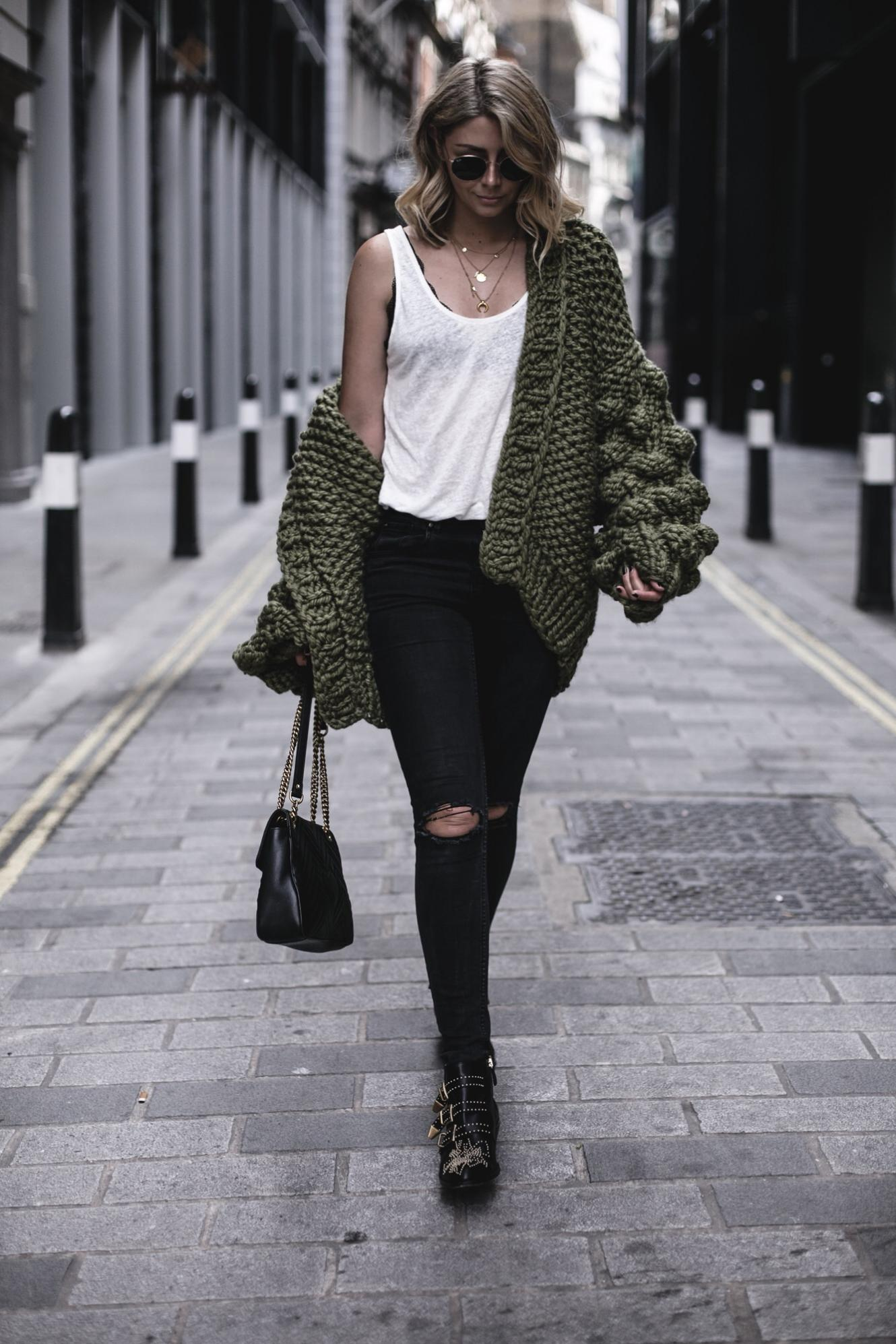 EJ Style | Mumshandmade chunky olive green cardigan, white linen vest top with black lace bra underneath, Gucci Marmont bag, black skinny jeans, Chloe Susanna boots
