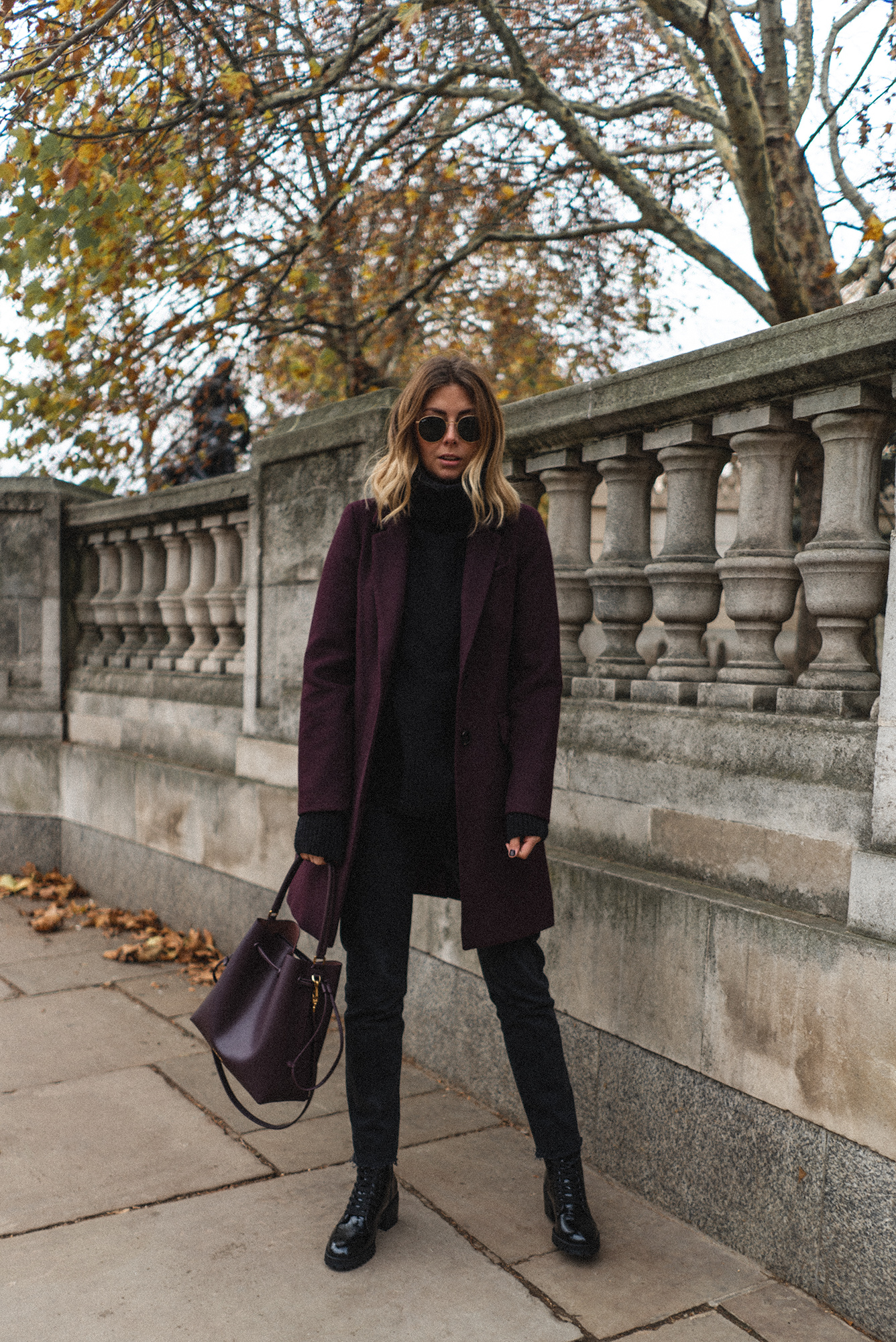 Emma Hill style, berry coat, black jeans, black boots, black chunky jumper, berry bucket bag, chic winter outfit-3