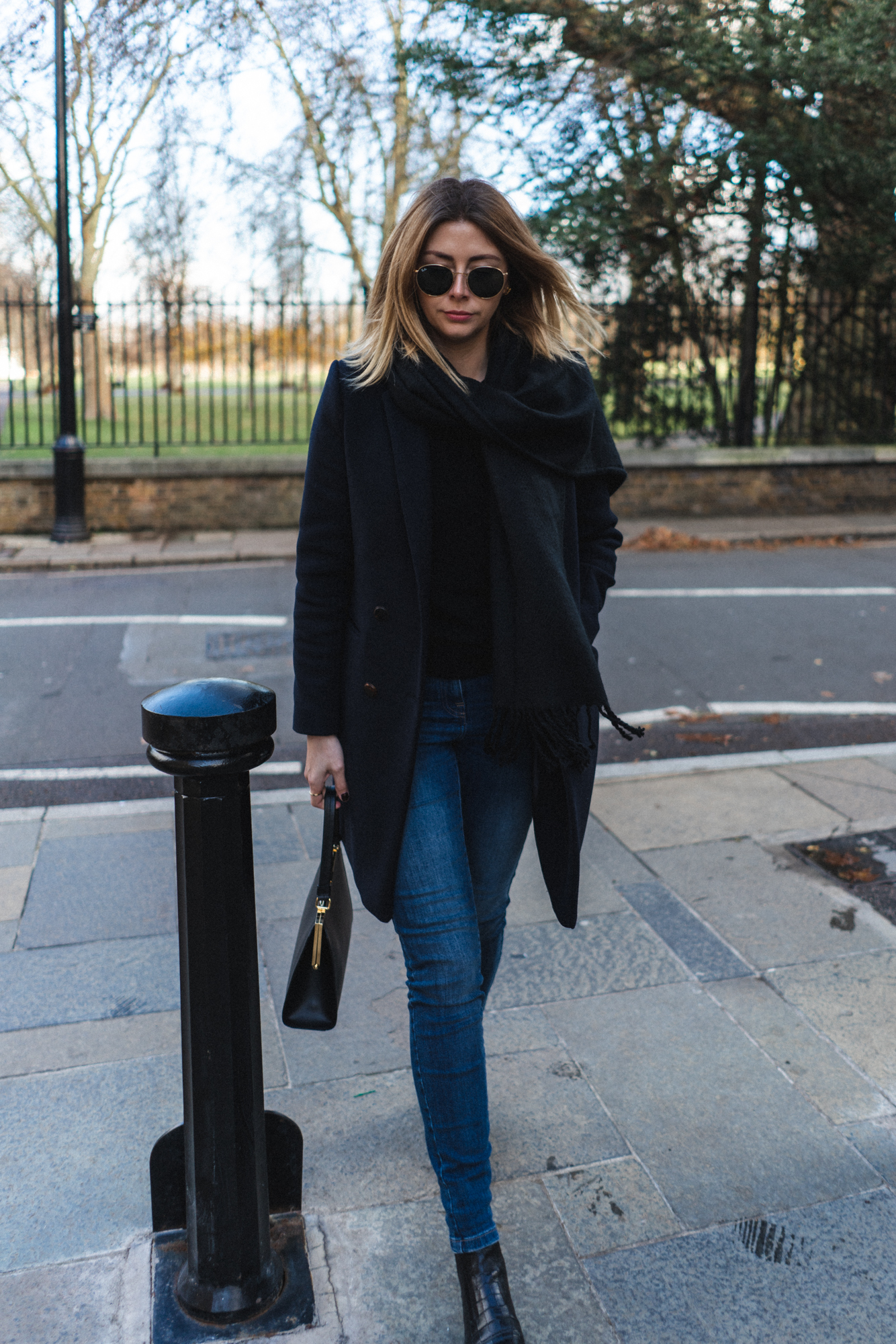 Emma Hill style, wearing navy coat, Mansur Gavriel Elegant bag, skinny jeans, black scarf, chic Autumn Winter outfit-6