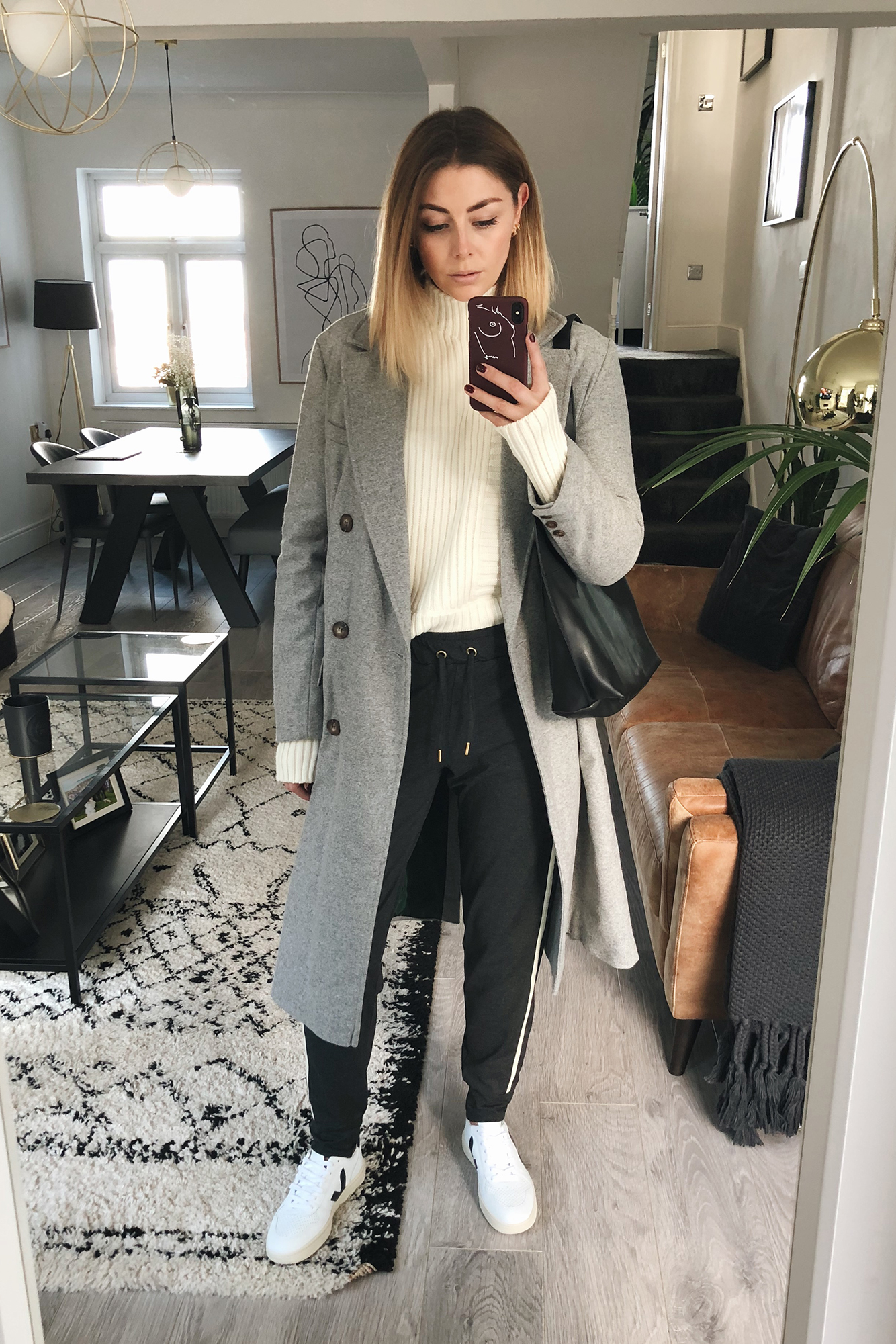 Emma Hill wearing grey doublke breasted winter coat, charcole grey jeggers with stripe, cream ribbed jumper, Veja V-10 sneakers, casual weekend outfit