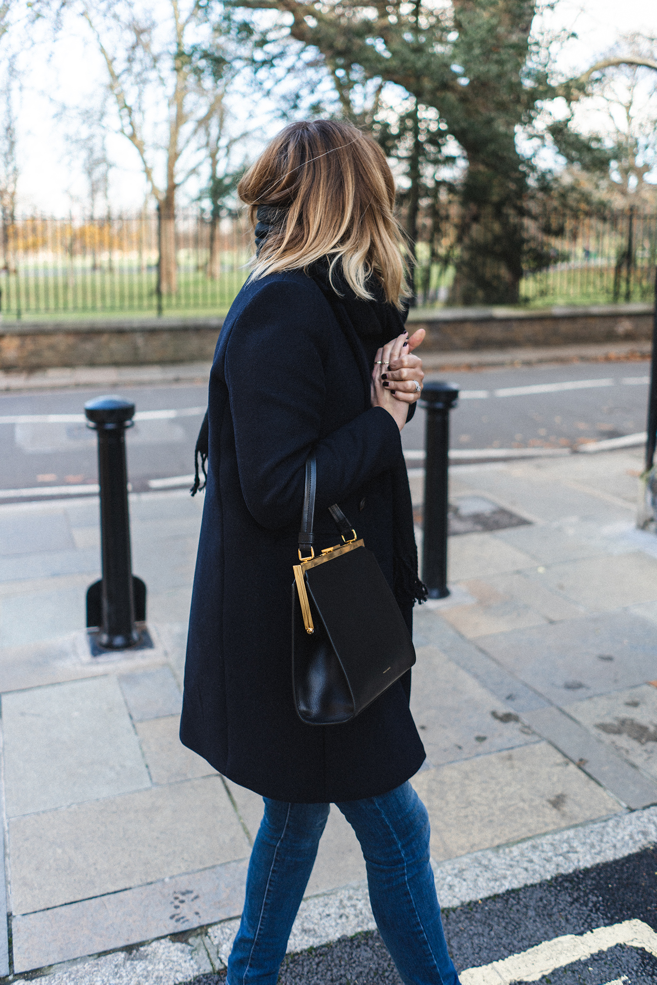Emma Hill wearing navy coat, Mansur Gavriel Elegant bag, chic winter outfit