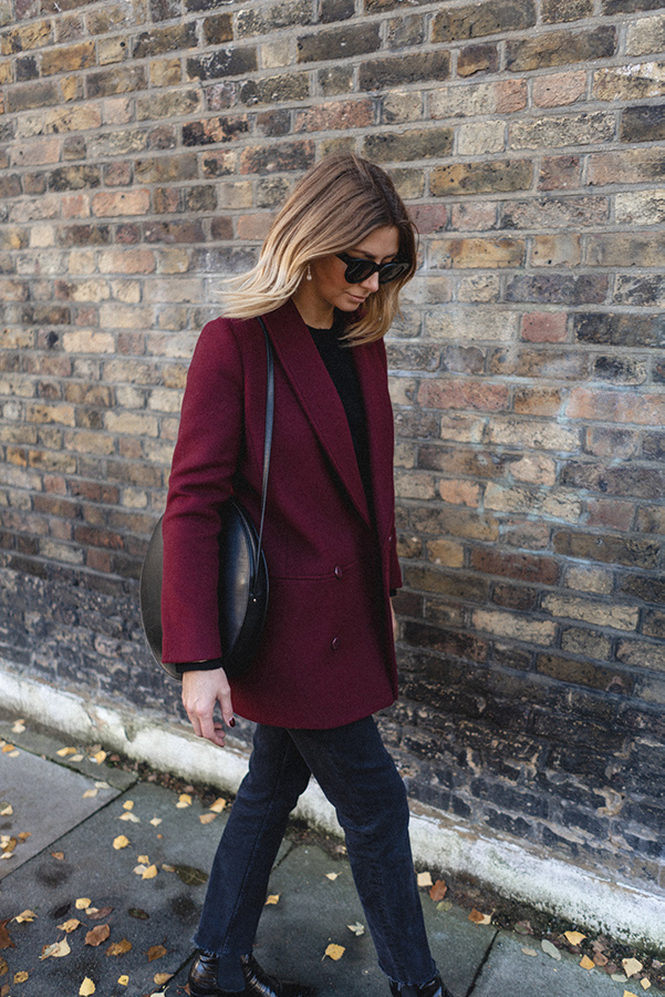 Emma Hill wears berry coat by Sezane