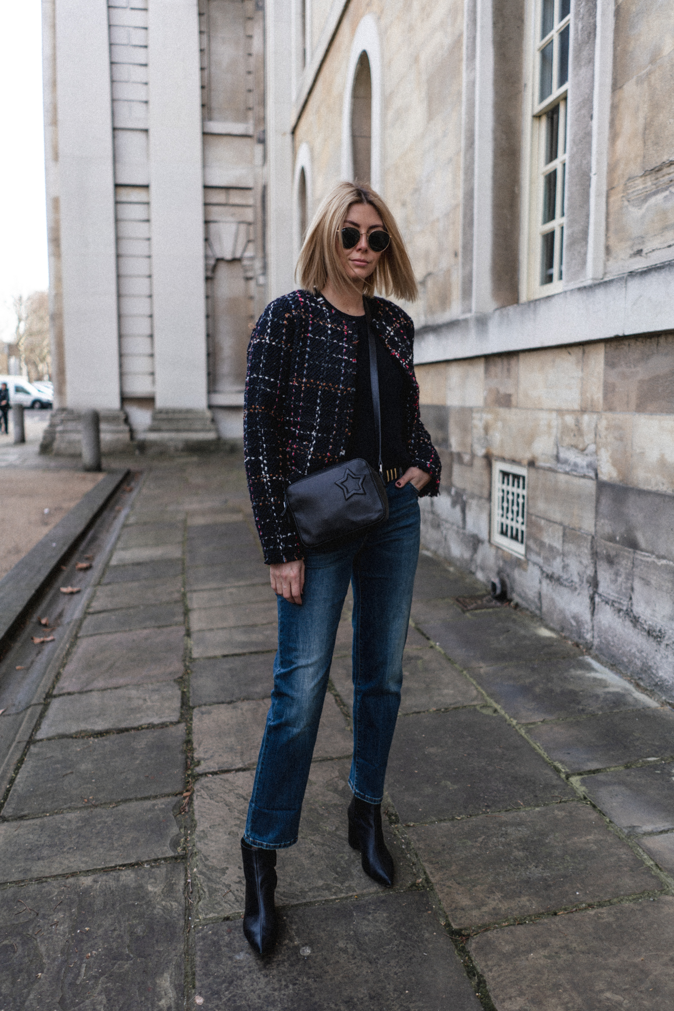 Emma Hill style. boucle teweed jacket blazer, black cross body bag, dark wash boyfriend jeans, black heeled ankle boots, london girl style, chic spring outfit