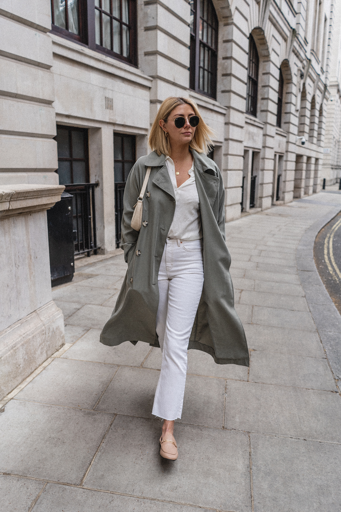 Emma Hill style, mint green trench coat, button up collared shirt, by FAR inspired mock croc cream bag, white jeans, gold necklace, nude loafers, Spring outfit ideas