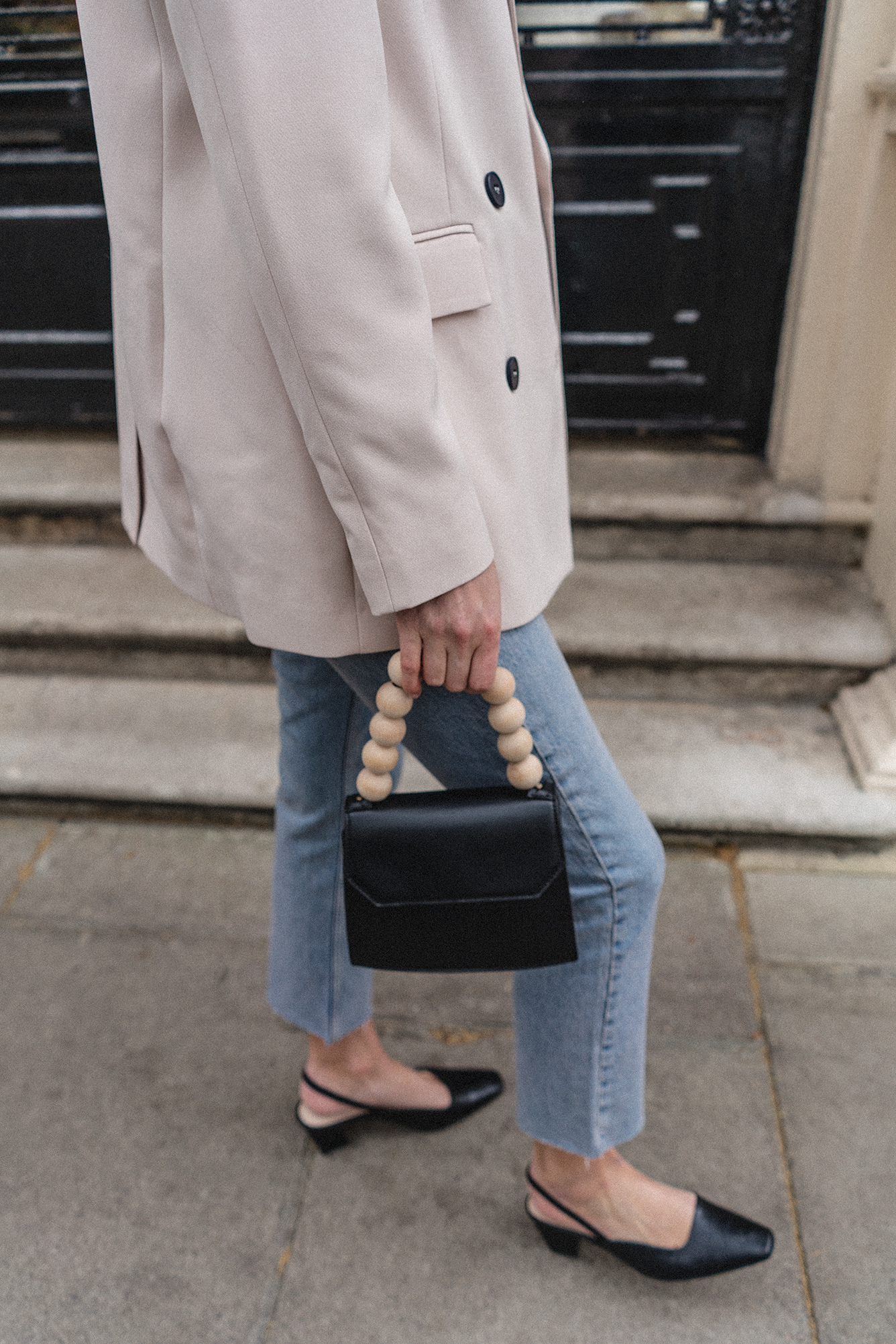 Emma Hill style, nude blazer, bleach light wash straight leg jeans, Black wooden beaded handle bag, black mock croc slingback shoes