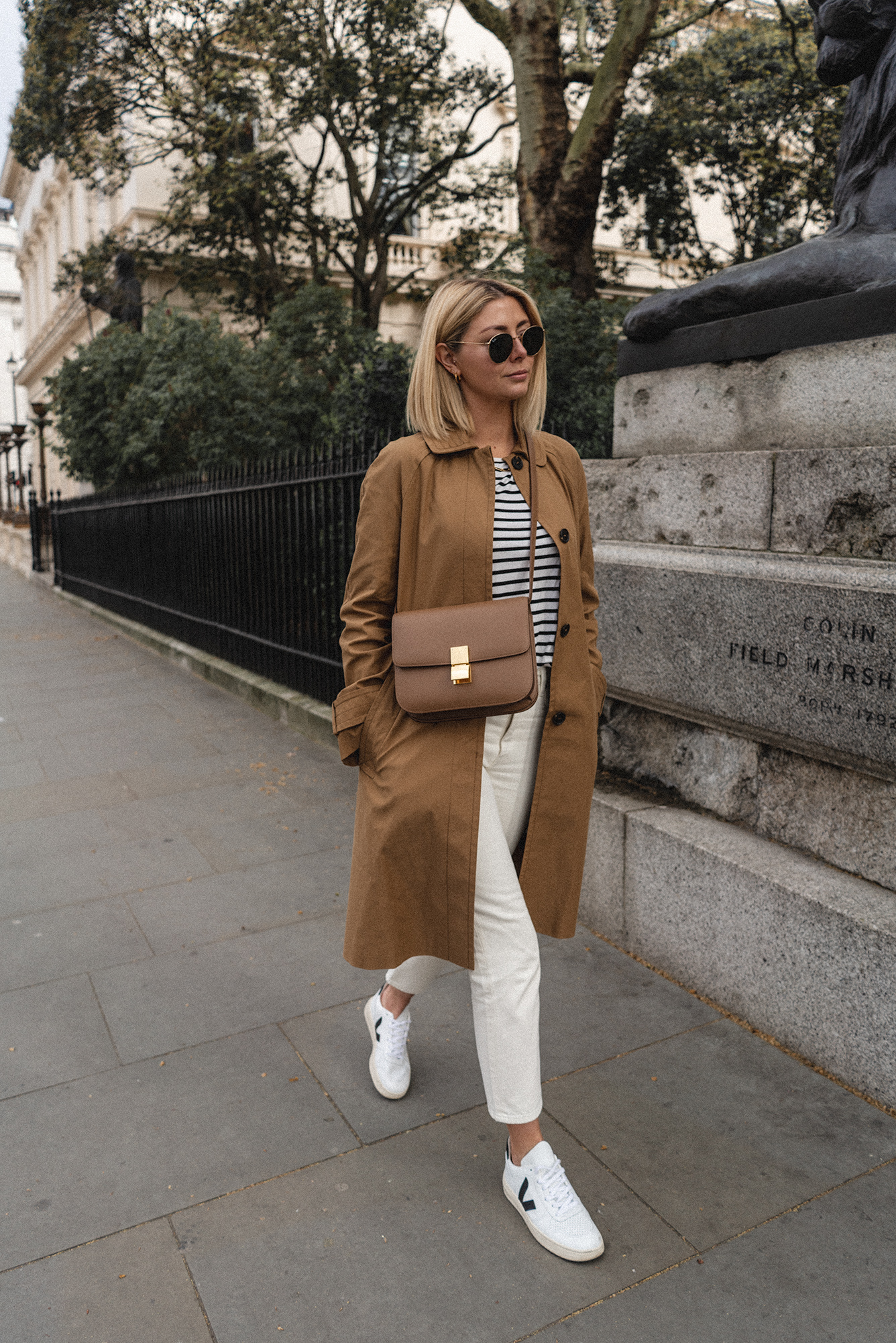Emma Hill style, tan mac coat, stripe t shirt, white jeans, Veja V-10 trainers, Celine Box Bag, chic Spring outfit