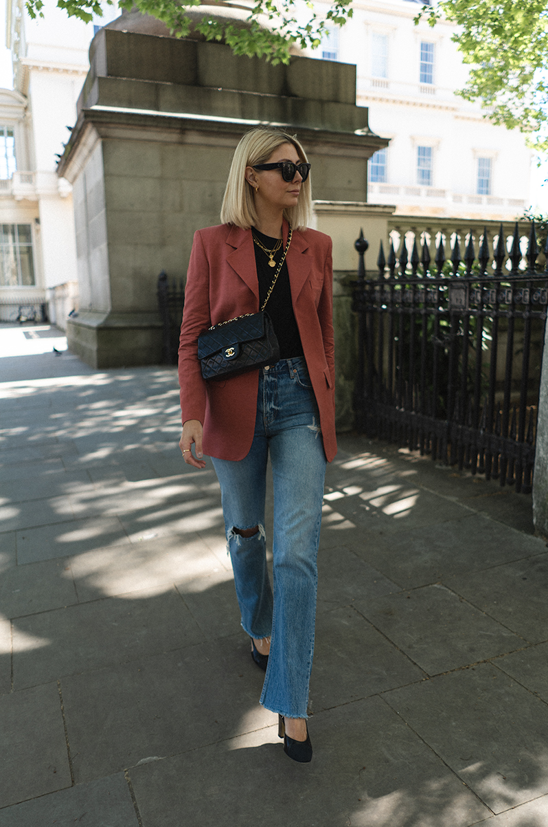 Emma Hill style. Vintage Chanel Classic bag via Vestiaire, teracotta blazer, ripped slouchy straight leg boyfriend jeans, black t-shirt, gold necklaces, Chanel slingbacks