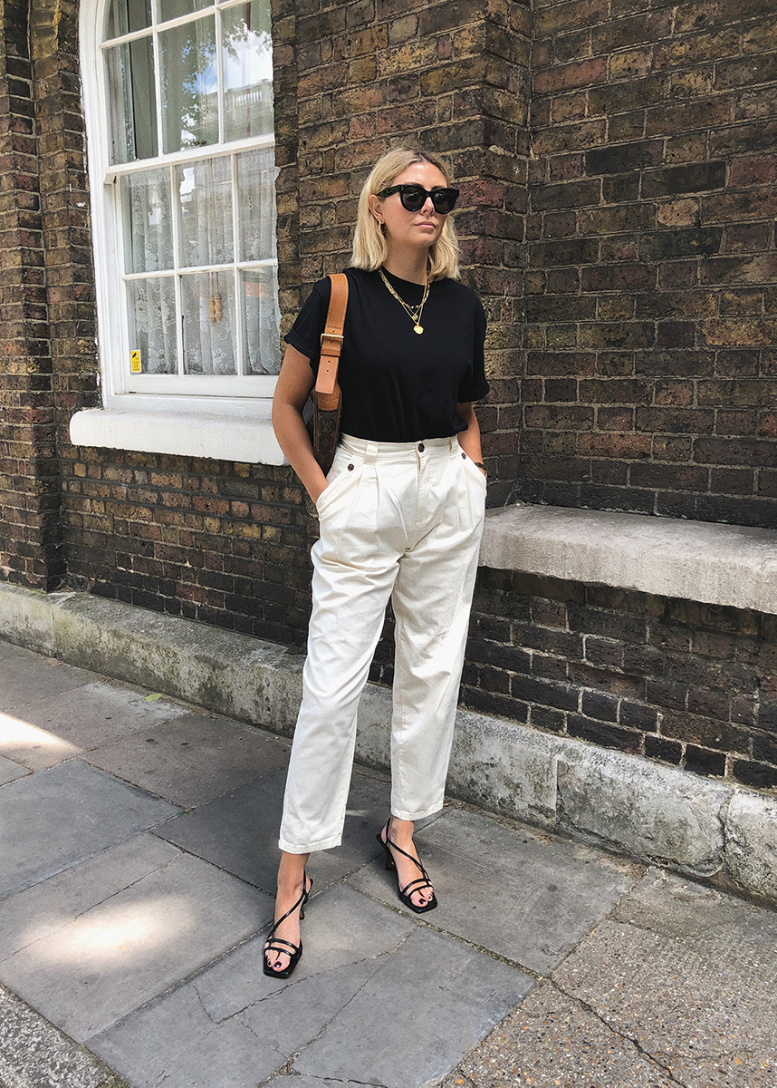 black t-shirt, white tailored trousers, vintage Louis Vuitton Croissant GM, chic monochrome outfit blog res