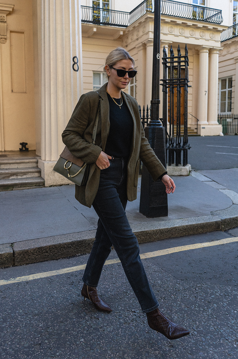 Emma Hill style. Green blazer, khaki Chloé Faye bag, black sweater, black striaght leg jeans, brown croc ankle boots, chic autumn fall outfit