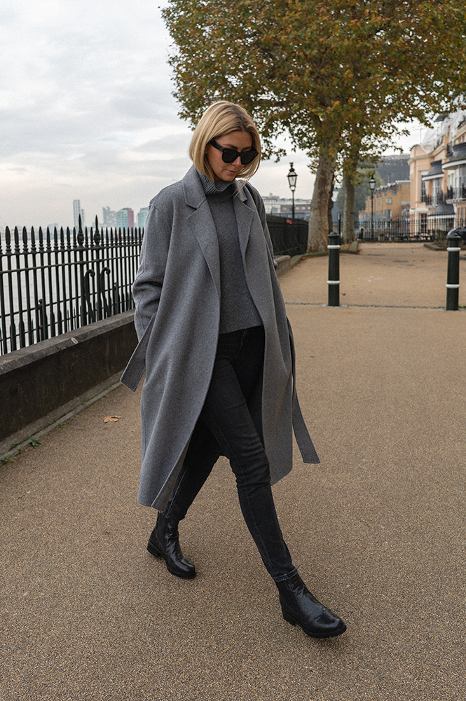 Emma Hill style. Grey wool wrap coat, grey high neck jumper, washed black jeans, chunky flat chelsea boots, Céline Baby Audrey sunglasses, chic casual outfit for Autumn Winter