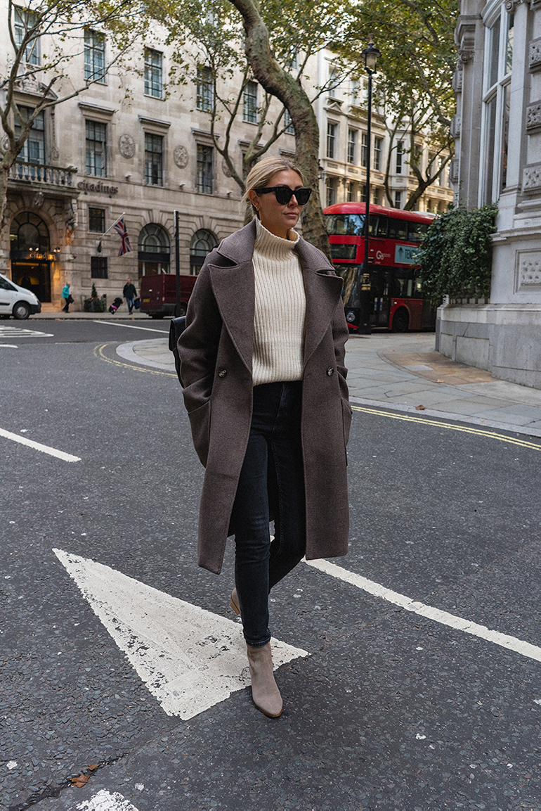 Emma Hill wears taupe wool coat, cream high neck ribbed jumper, washed black skinny jeans, suede ankle boots, Celine baby audrey sunglasses, chic Autumn outfit