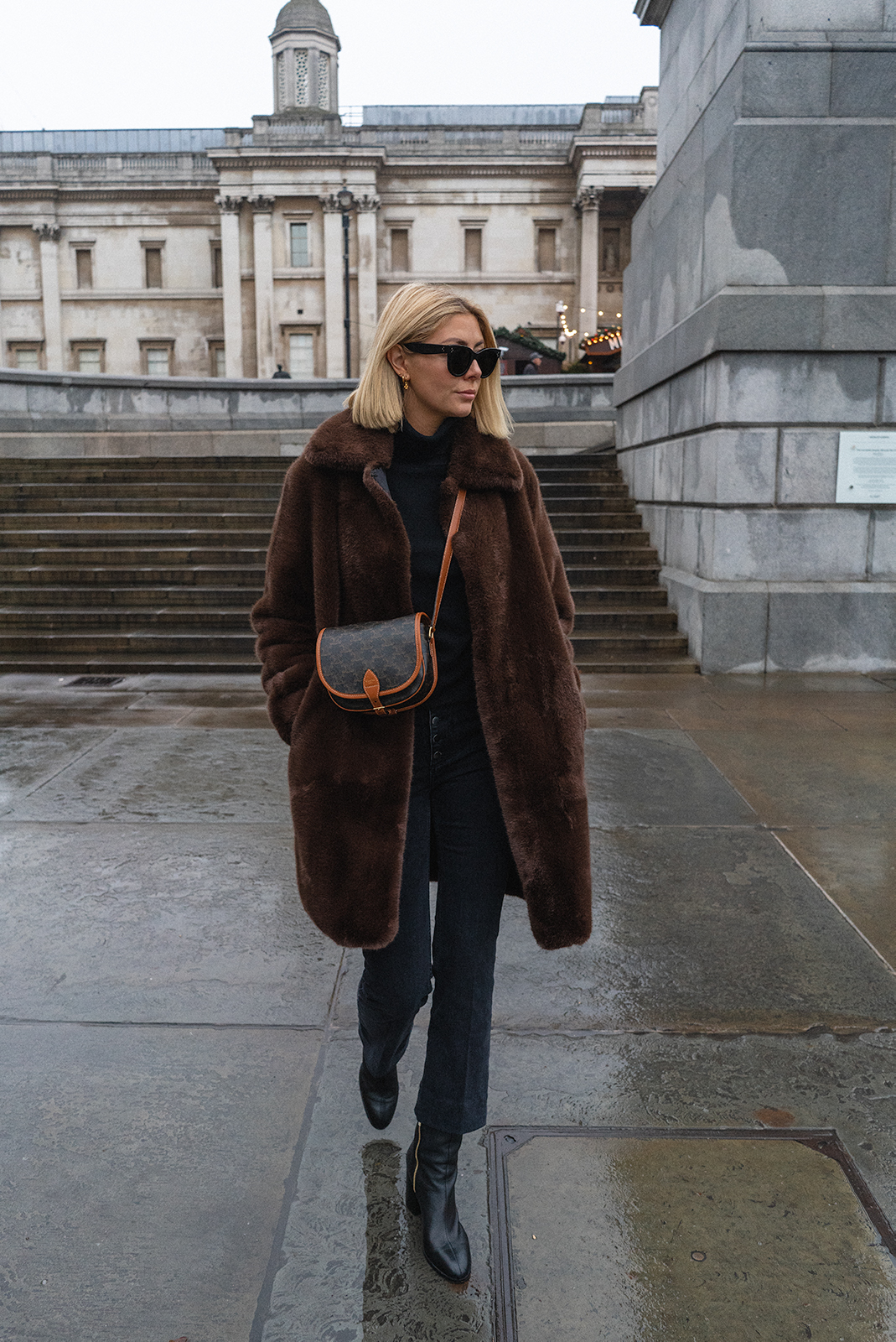 Emma Hill style. Brown faux fur coat, black cropped flare jeans, Celine Falco bag, black ankle boots, cosy autumn winter outfit