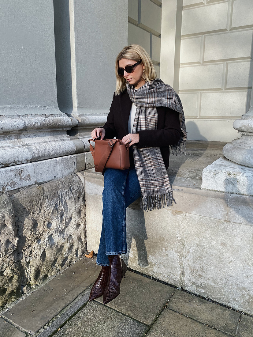 Emma Hill wears brown blazer, checked scarf, straight leg jeans, Everlane tan leather form mini bag, dear frances Kit boots, chic autumn outfit