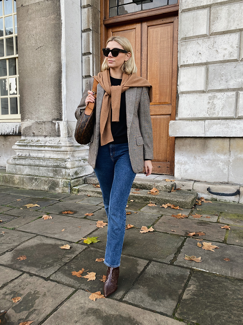 Emma Hill wears vintage mens blazer, jumper worn over shoulders, straight leg jeans, Dear Frances Kit boots, chic autumn fall outfit