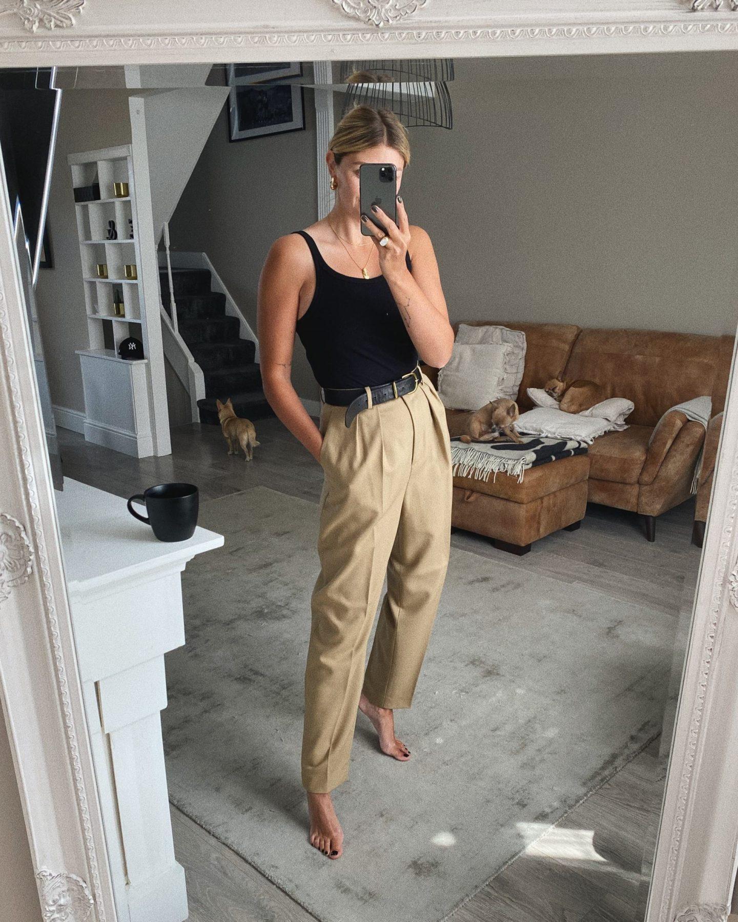 Black vest, camel trousers, gold jewellery, Emma Hill style