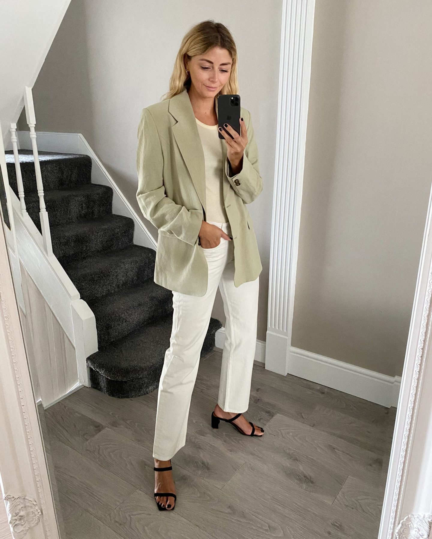 Emma Hill style, light green blazer, yellow vest tank top, off white jeans, black ByFar Tanya sandals