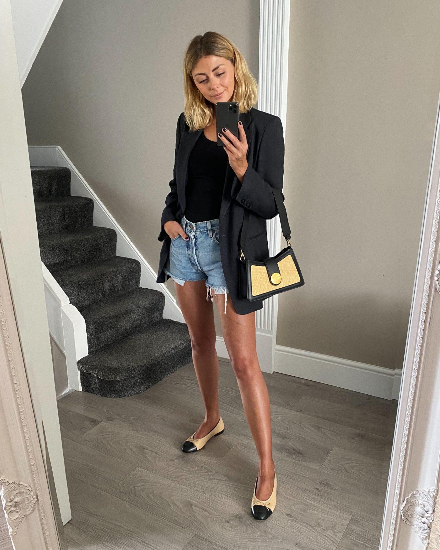 Emma Hill style. Navy linen blazer, Chanel ballet pumps flats, vintage Levi's 501 cut offs denim shorts. Summer outfit